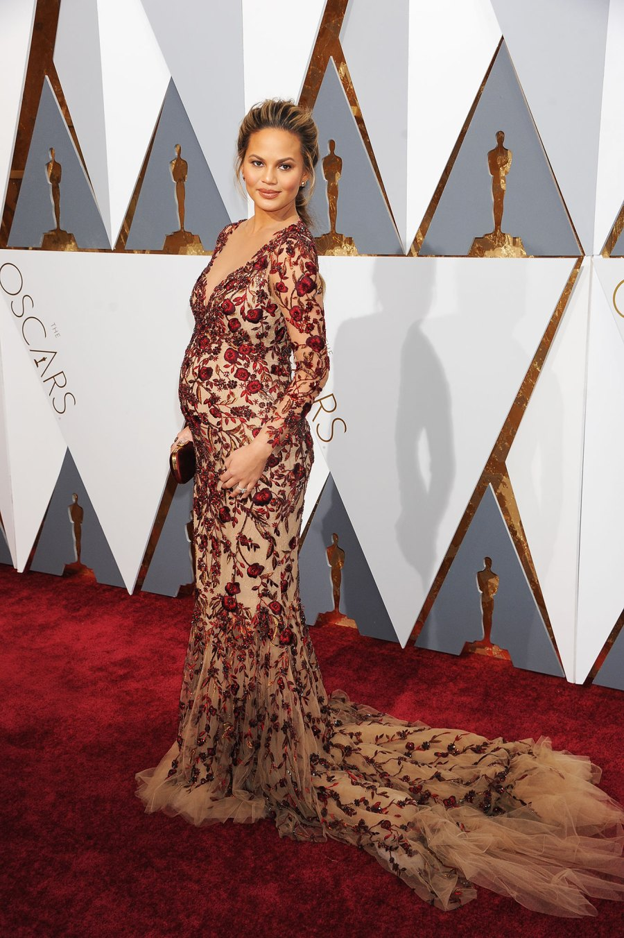 Chrissy Teigen Pregnant Celebrities Showing Off Their Baby Bumps on the Oscars Red Carpet
