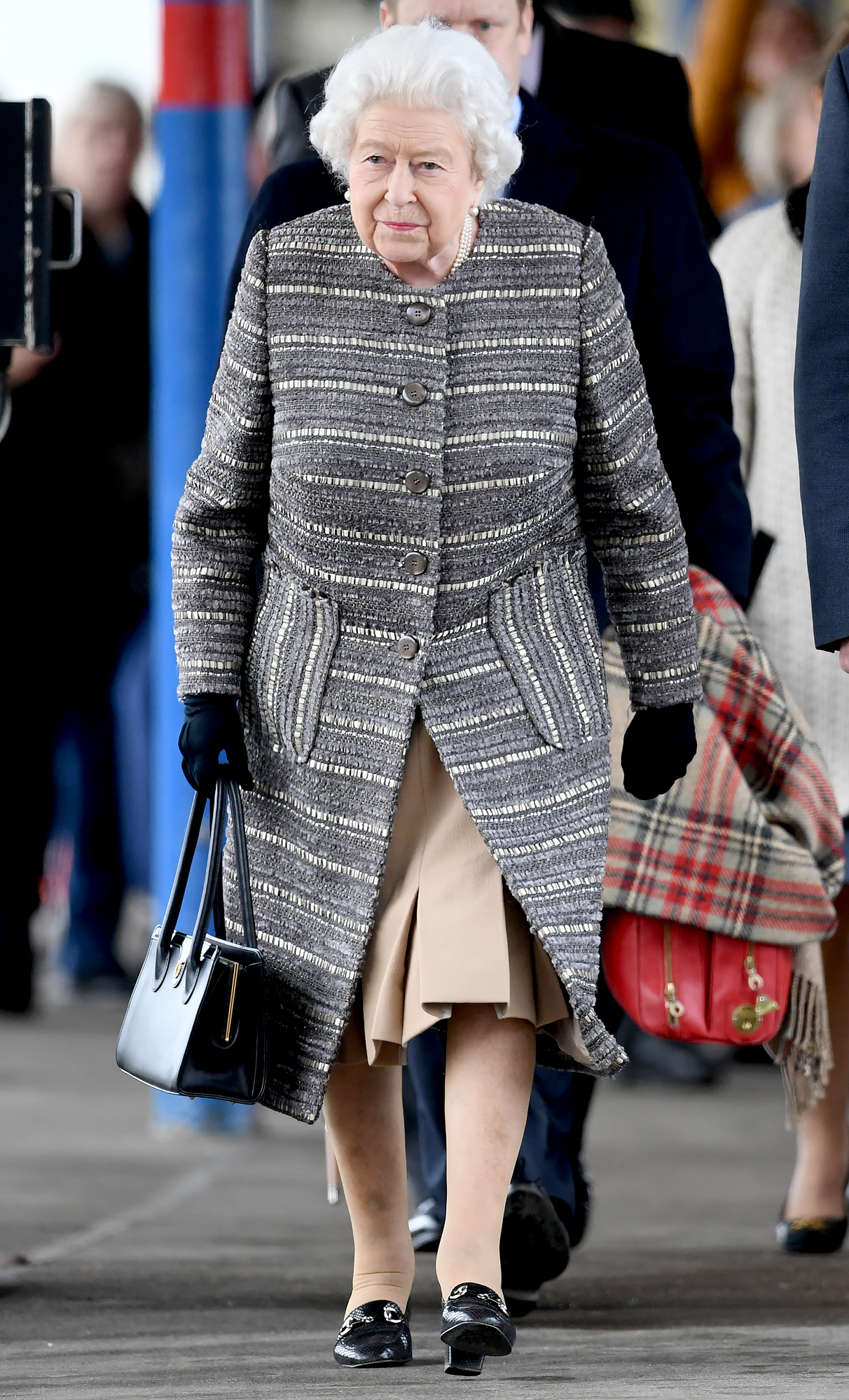 Queen-Elizabeth-Kings-Lynn-Railway-Station-5 - Queen Elizabeth II arrives at King's Lynn railway station in Norfolk to board a train to return to London, after spending the Christmas period at Sandringham House in north Norfolk. (Photo by Joe Giddens/PA Images via Getty Images)