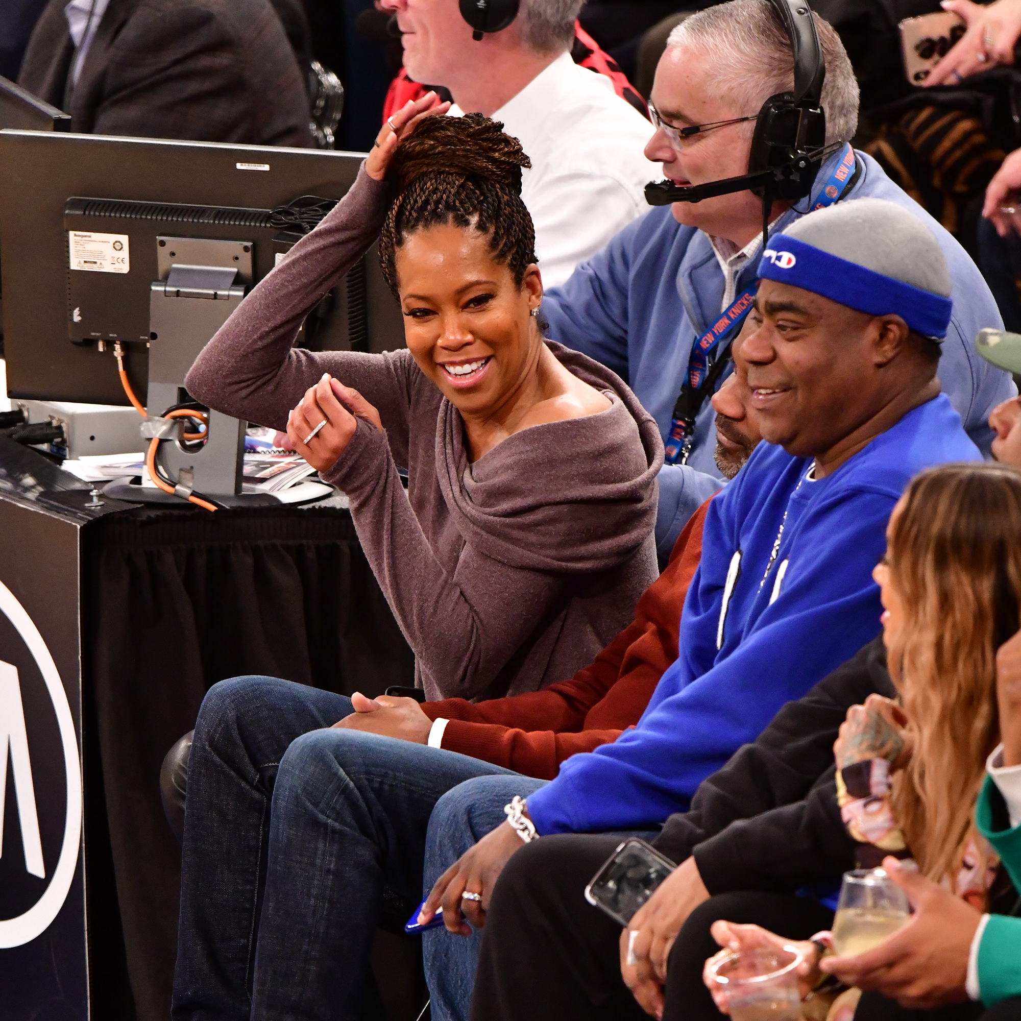 Regina King Is Nearly Taken Out by 76ers Player Joel Embiid at Basketball Game - Regina King and Tracy Morgan attend Philadelphia 76ers v New York Knicks game at Madison Square Garden on February 13, 2019 in New York City.