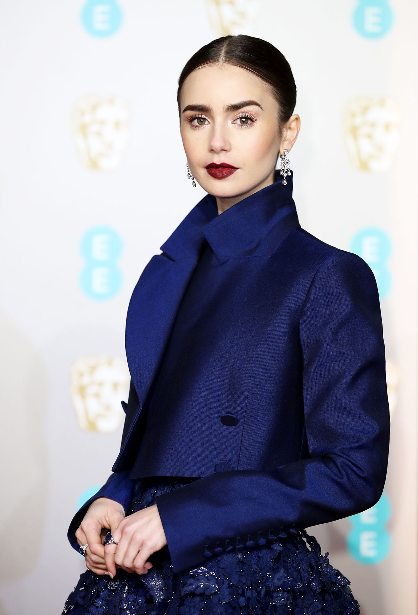 Lily Collins - Lily Collins attends the EE British Academy Film Awards at Royal Albert Hall on February 10, 2019 in London, England.