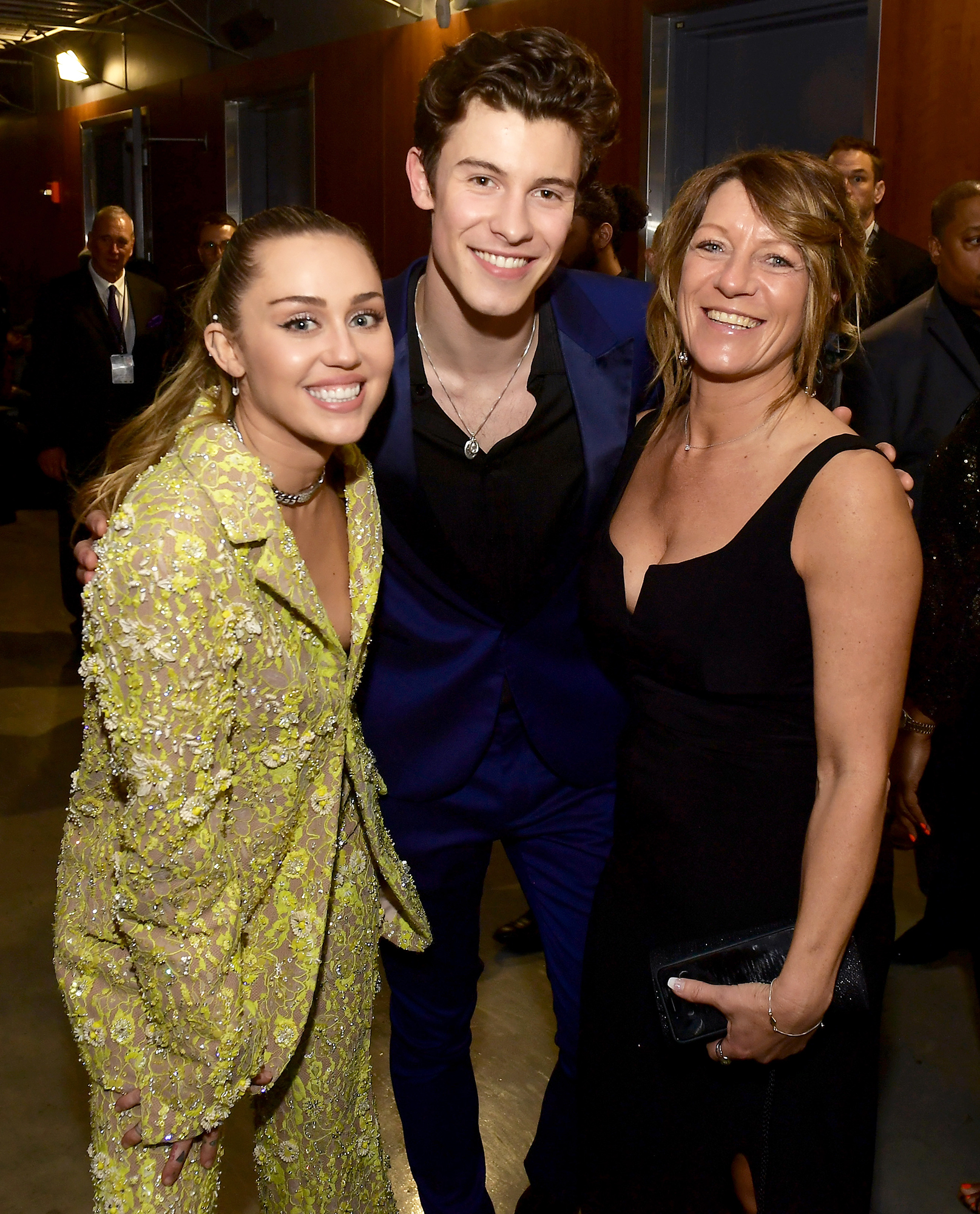 Shawn Mendes Karen Mendes miley cyrus STARS BRINGING FAMILY TO GRAMMYS 2019 - A family affair! Not only did the musician bring his dad to the Grammys, but Mendes and Miley Cyrus posed for a pic with his mom as well.