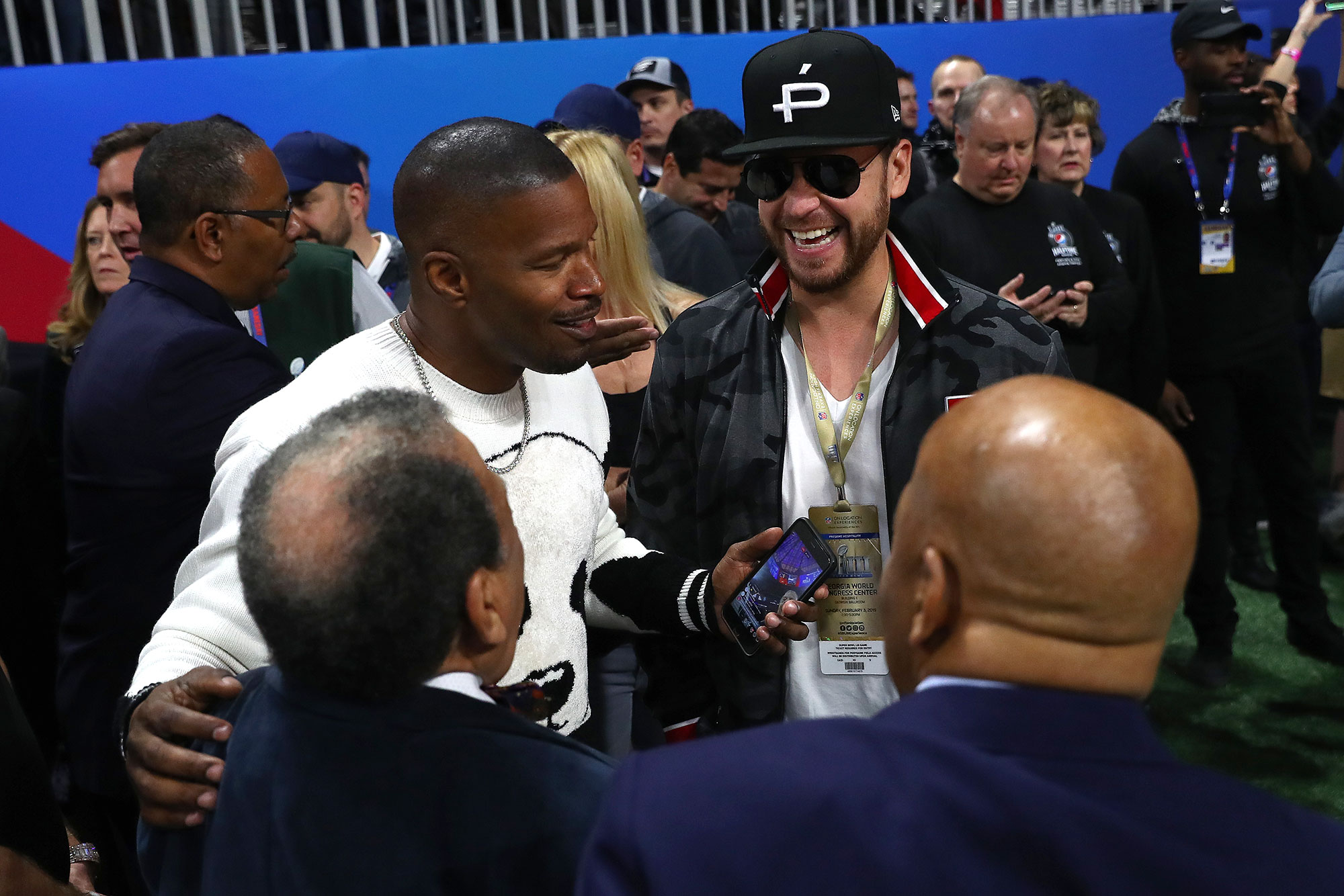 Gallery Super-Bowl-53-Jamie-Foxx - The actor-singer hung out with a group of people on the sidelines.