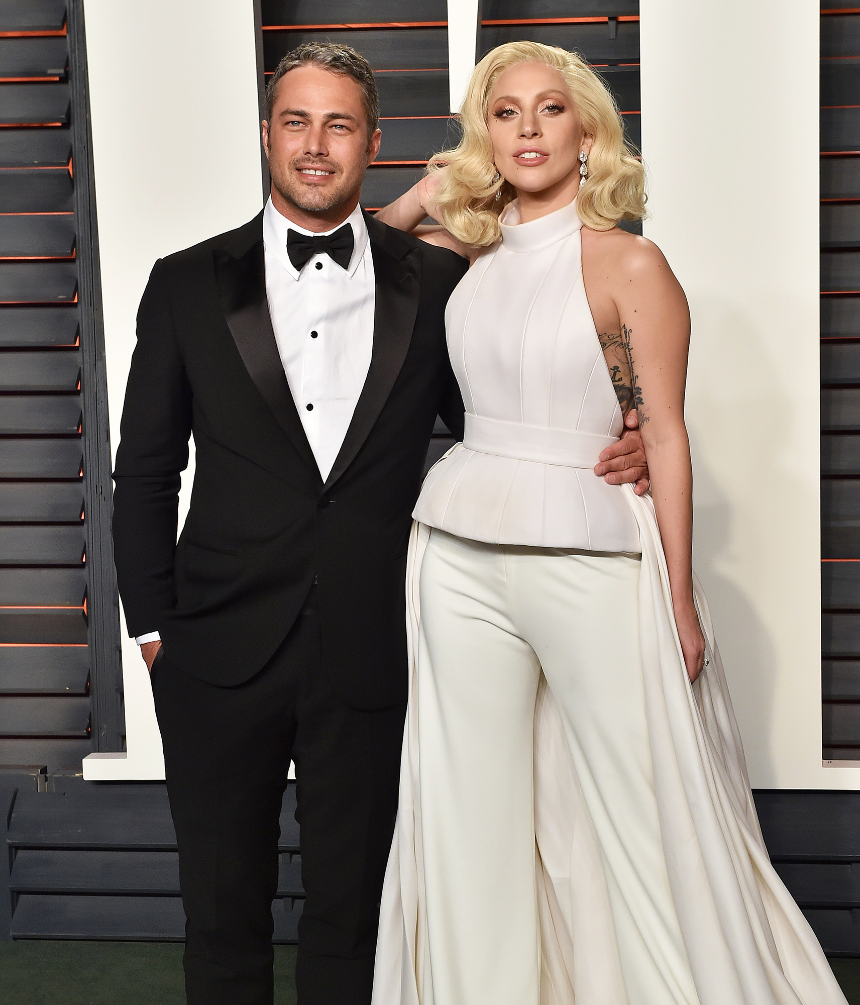 Taylor Kinney Apologizes to Ex Lady Gaga After Liking Shady Comment About Her - Taylor Kinney and Lady Gaga arrive at the 2016 Vanity Fair Oscar Party Hosted By Graydon Carter at Wallis Annenberg Center for the Performing Arts on February 28, 2016 in Beverly Hills, California.