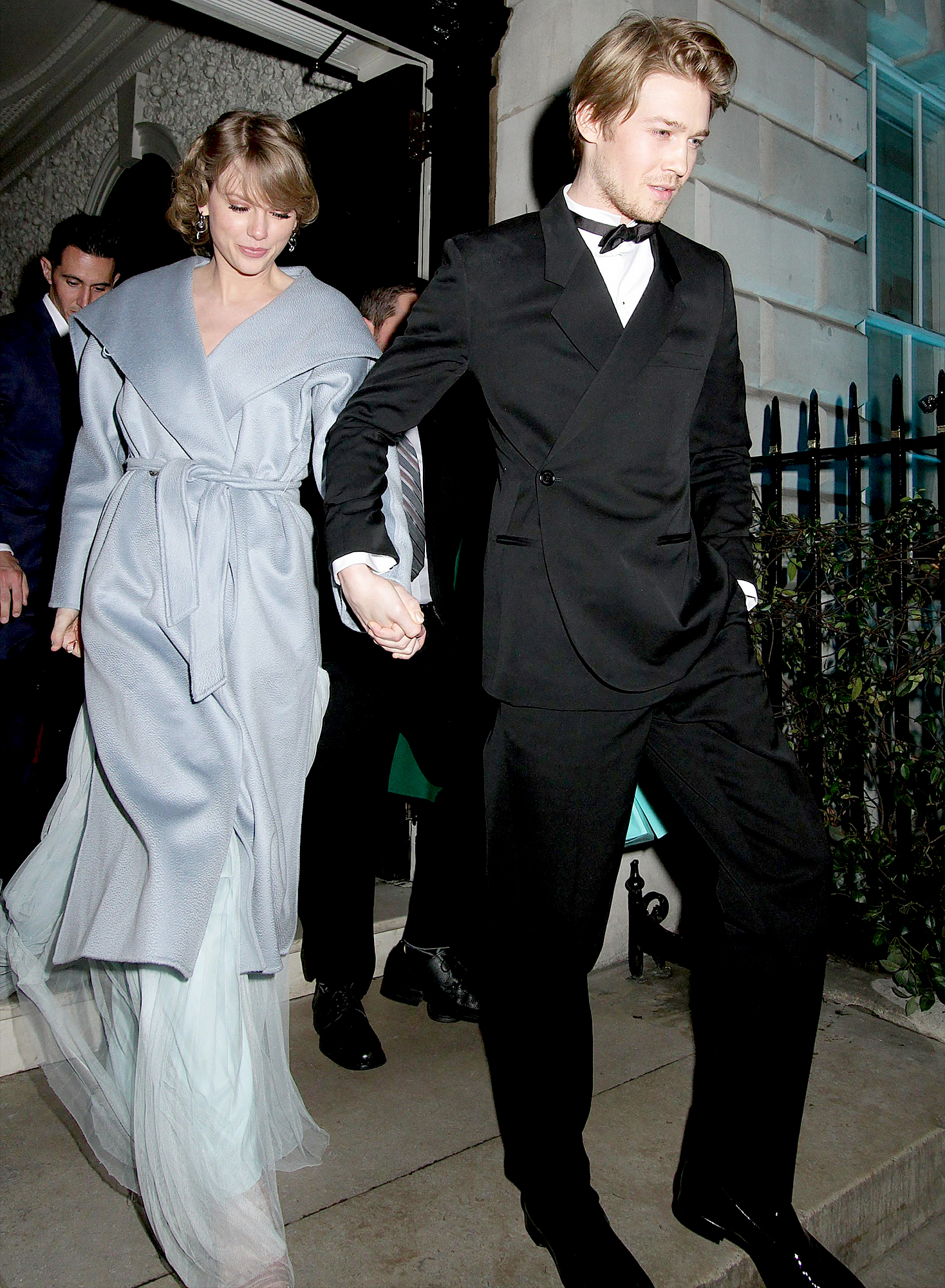 Taylor-Swift-Joe-Alwyn-bafta-after-party-1 - Alwyn walked a step in front of Swift as he guided her down a flight of stairs by holding her hand.