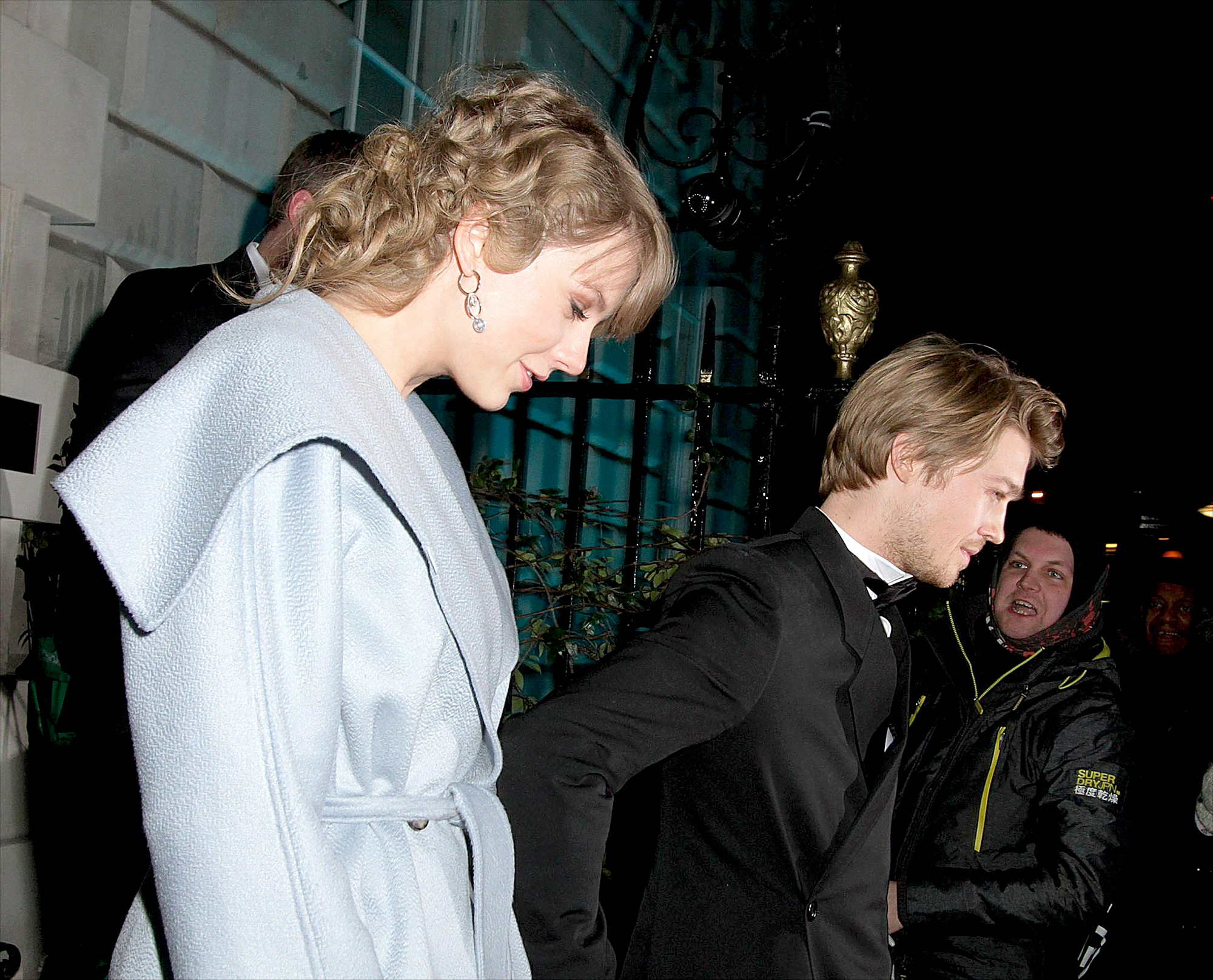 Taylor-Swift-Joe-Alwyn-bafta-after-party-6 - Both Swift and Alwyn took in the night with grins on their face as they appeared to not be bothered by the rain or the snapping of photos.