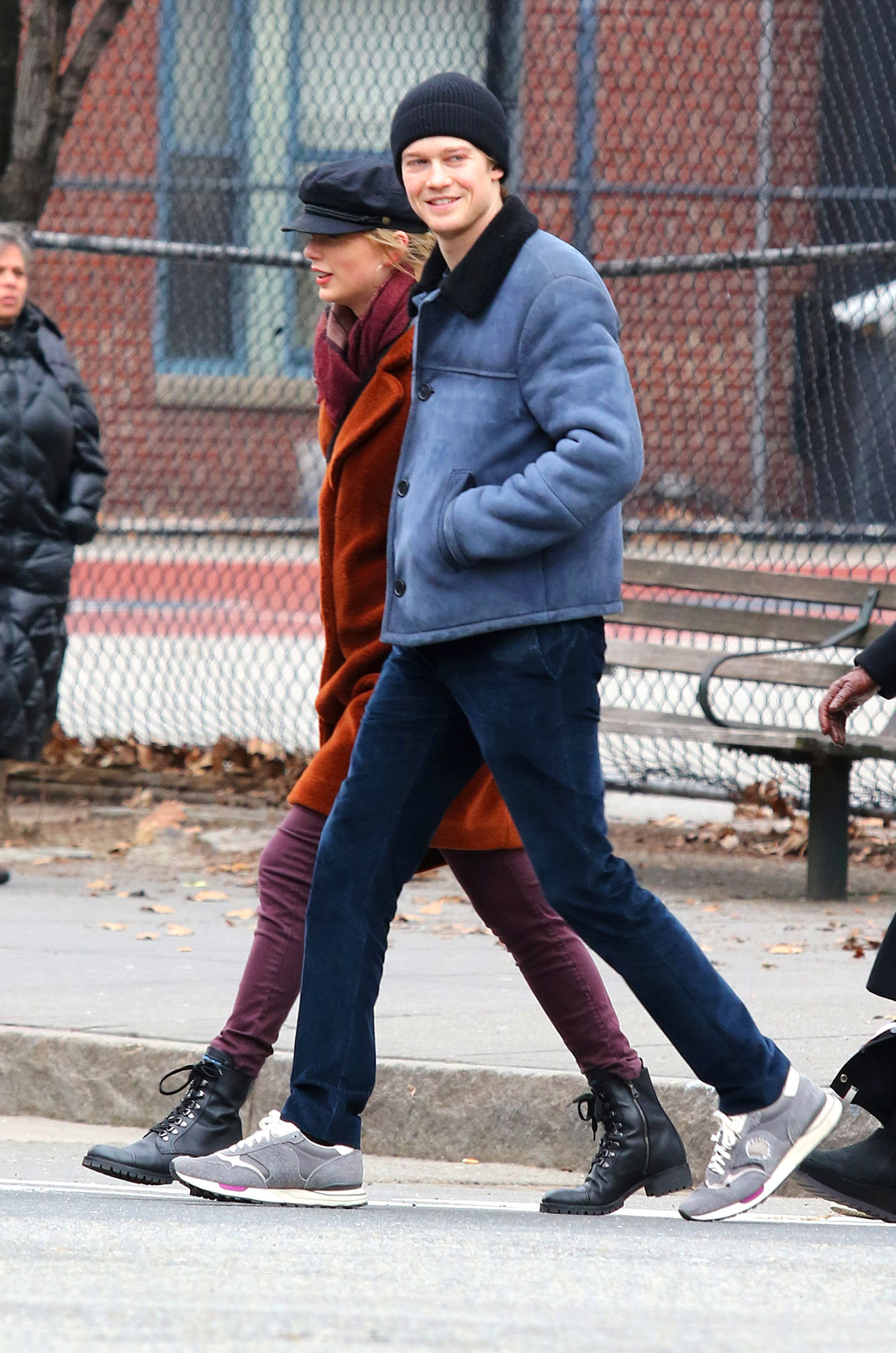 Taylor Swift and Joe Alwyn: A Timeline of Their 'Gorgeous' Relationship - The happy duo took a hand-in-hand stroll in New York City the day before New Year's Eve, with Swift in a burnt orange coat and a cap and the Mary Queen of Scots actor in a blue shearling jacket, jeans and a beanie.