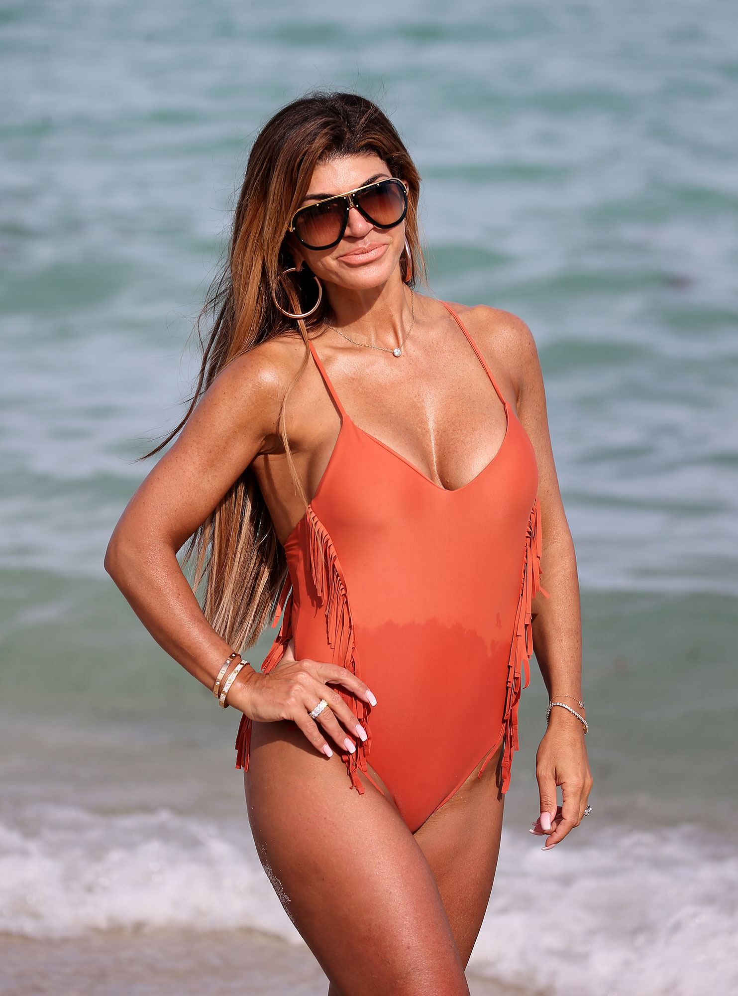 Teresa Giudice Looks Carefree in Swimsuit on the Beach Amid Joe Giudice Drama - * PREMIUM EXCLUSIVE* Real Housewives of New Jersey star Teresa Giudice looks amazing in a peach swimsuit as she takes a walk along the beach in Miami. 15 Feb 2019 Pictured: Teresa Giudice.