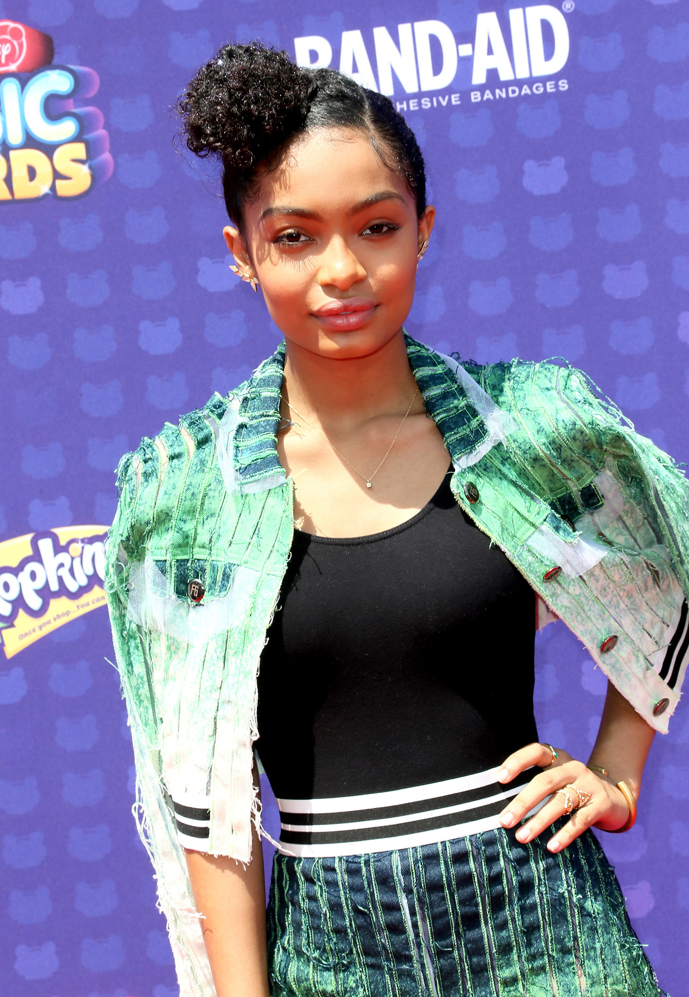 Yara Shahidi - Shahidi is the queen of the poof-like bun, and this asymmetrical, forehead-grazing placement at the 2016 Radio Disney Music Awards gave it a whole new twist.