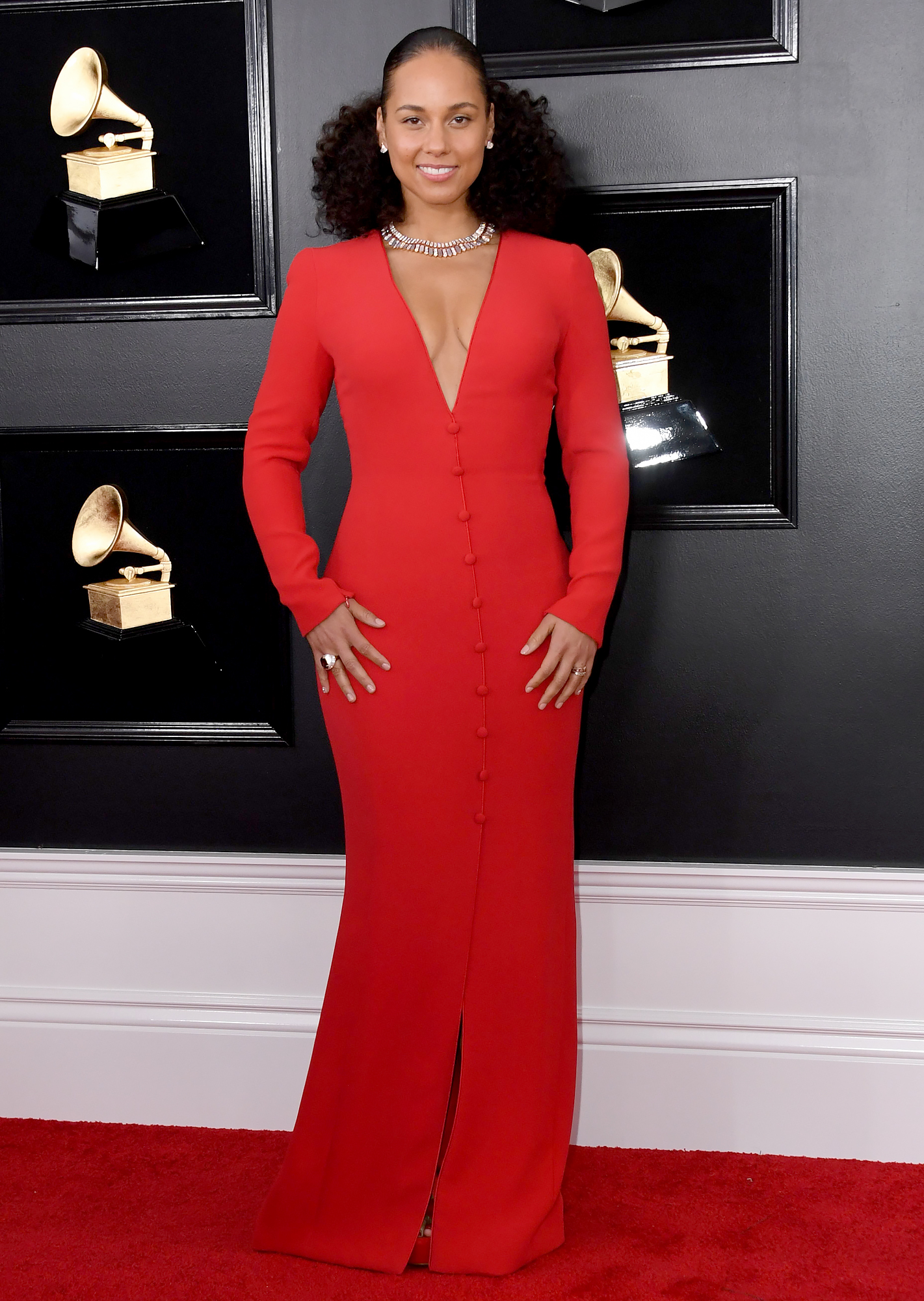 "alicia-keys-grammys-2019-looks-2 - Kicking things off with a bang, the ""If I Ain't Got You"" crooner rocked a crimson Armani Prive gown with Bulgari jewels and Aquazzura heels on the red carpet."