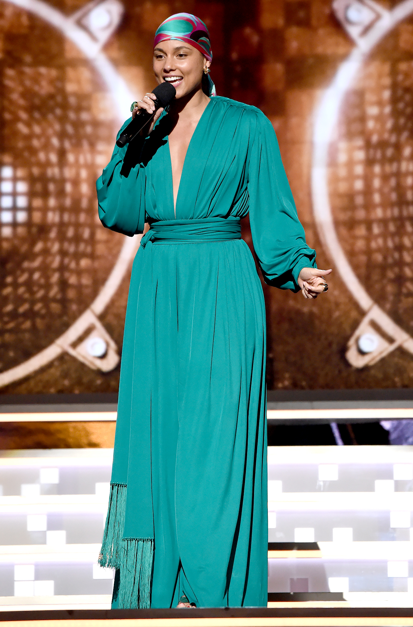 alicia-keys-grammys-2019-looks-5 - Giving Us all the '70s vibes, Keys opened the show in a teal Oscar de la Renta jumpsuit that she paired with a printed Emilio Pucci headscarf and Jill Heller and Cartier jewelry.