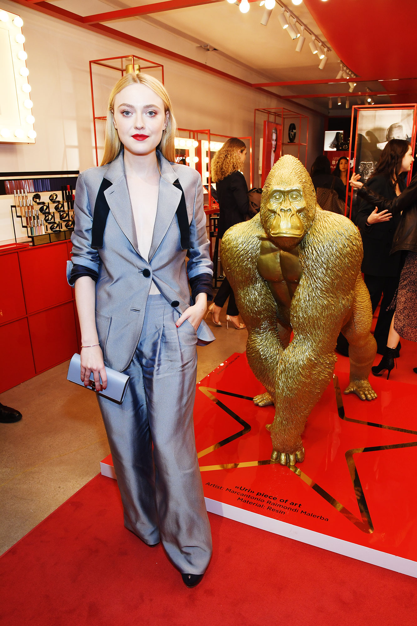 Dakota Fanning - When attending the Armani Box opening event in LA on February 6, the Alienist actress wore a slouchy grey ensemble with black details that looked seriously cool.