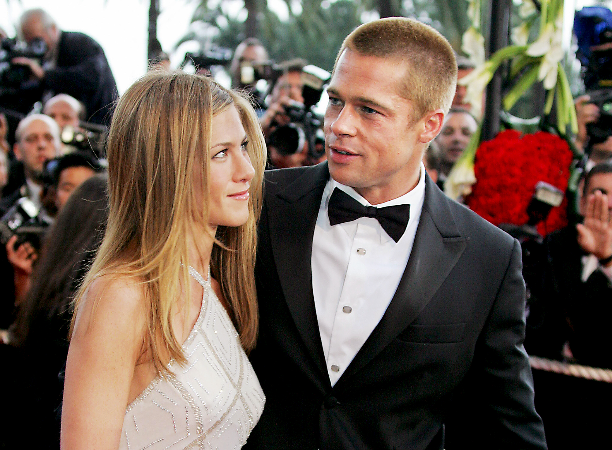 """jennifer-aniston-brad-pitt-divorce-relationship - CANNES, France: US actor Brad Pitt (C) waves as he and his wife Jennifer Aniston (R) arrive for the official projection of US director Wolfgang Petersen's (L) film """"Troy"""" , 13 May 2004, at the 57th Cannes Film Festival in the French Riviera town. Hollywood took over the French Riviera today as Brad Pitt and […]"""