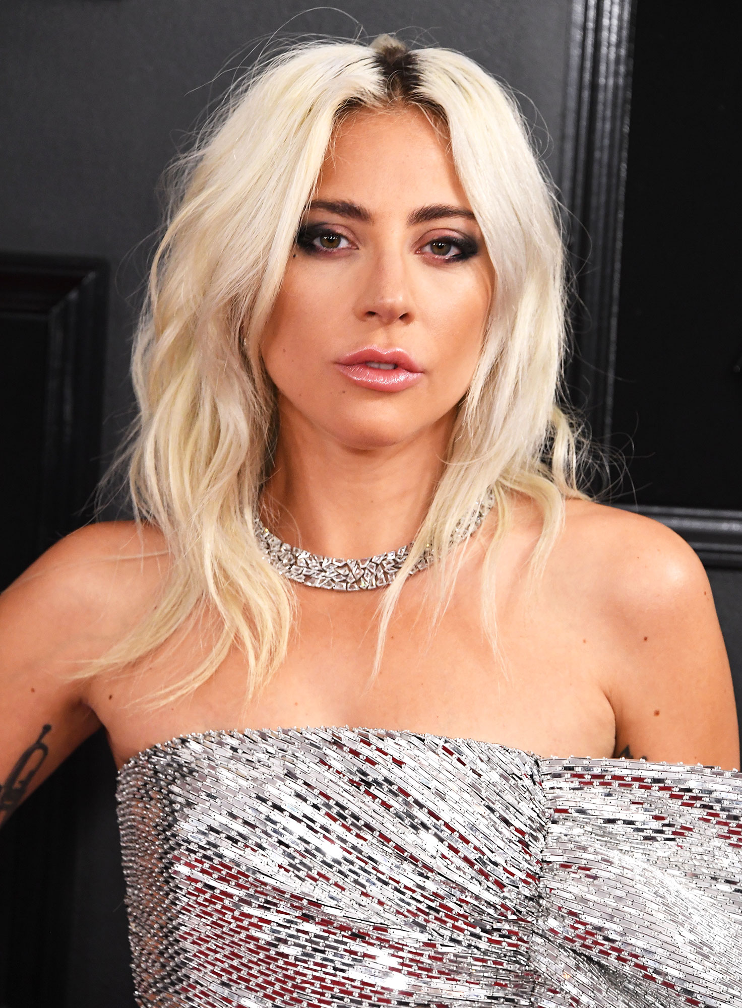 grammys 2019 Lady Gaga - What hair to wear with the best-dressed gown of the night? If you're Gaga, you go decidedly low-key with undone waves.