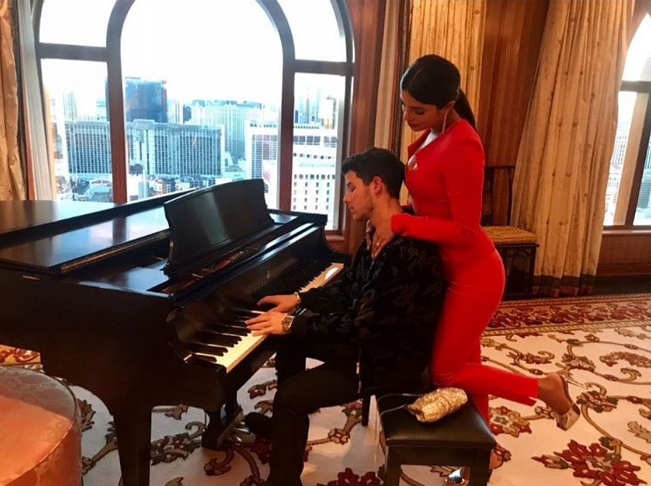 "Nick Jonas and Priyanka Chopra Valentines Gallery - The ""Jealous"" singer expressed his gratitude for his wife with a sweet Instagram photo of her snuggled up behind him as he played piano. ""How lucky am I ..."" he wrote on Thursday."