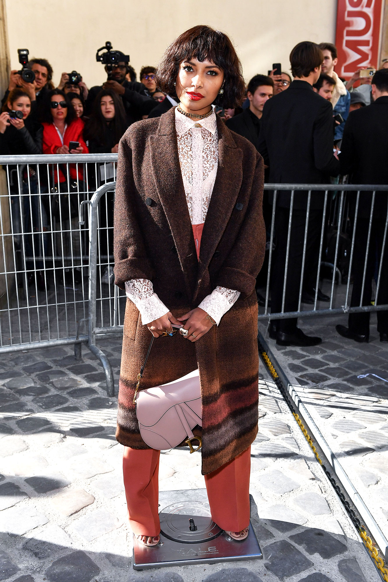Kat Graham See the Stars' Street Style at Paris Fashion Week - The multi-hyphenate was a lacy lady in a sheer top, high-waisted trousers and cozy overcoat at Dior on Tuesday, February 26.