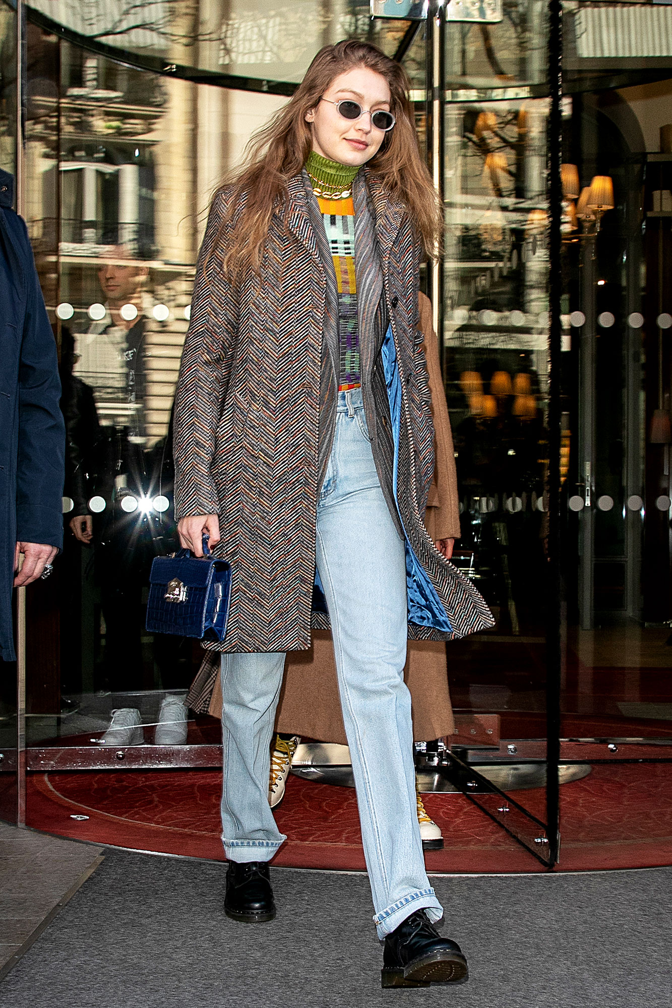 See the Stars' Street Style at Paris Fashion Week - It was all about the layers for the blonde beauty in light-wash jeans, a Missoni sweater, tweed jacket and Dr. Martens on Monday, February 25.