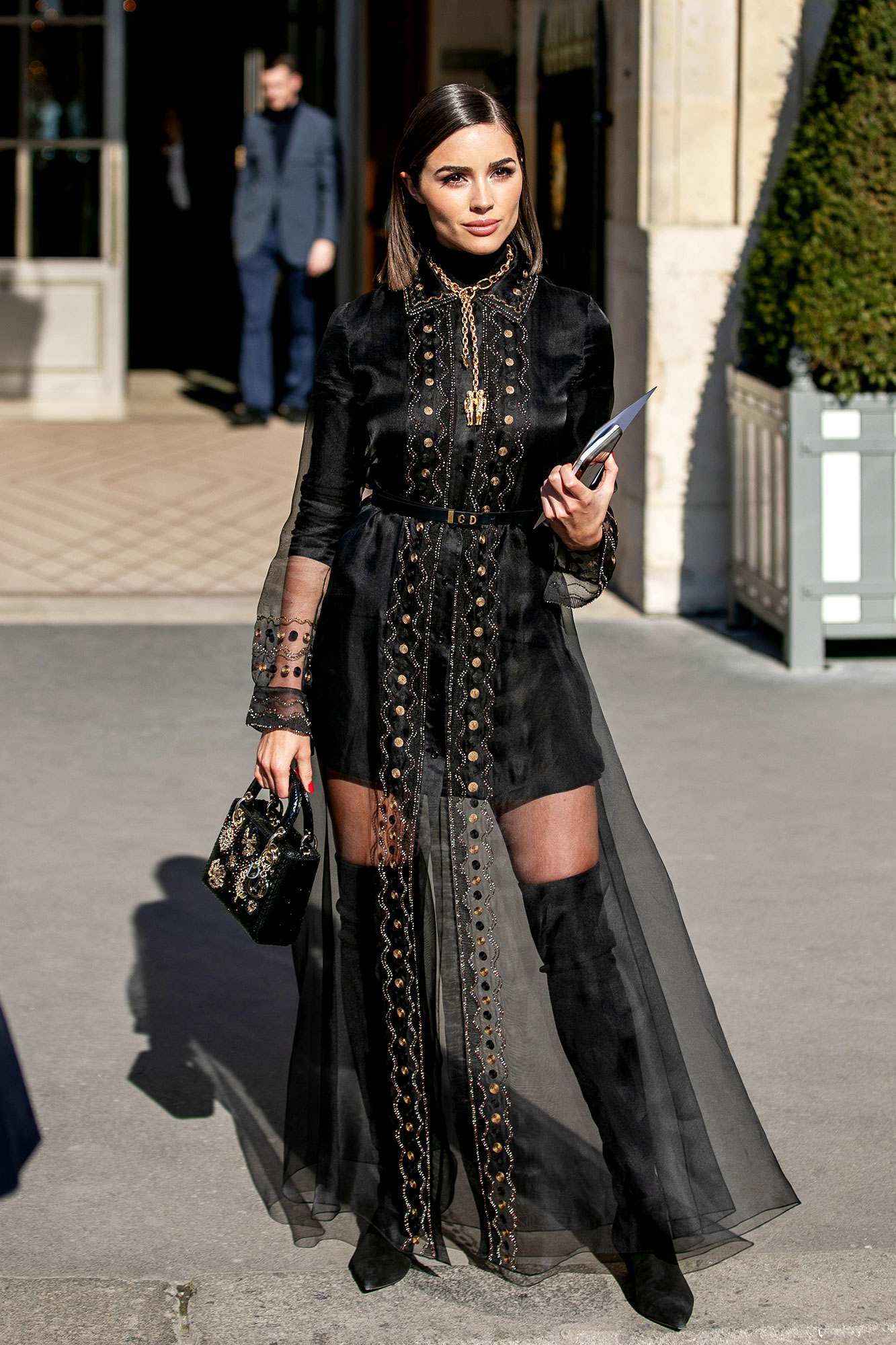 Olivia Culpo See the Stars' Street Style at Paris Fashion Week - The model proved black is anything but boring in her noir minidress and embellished sheer duster on Wednesday, February 26.