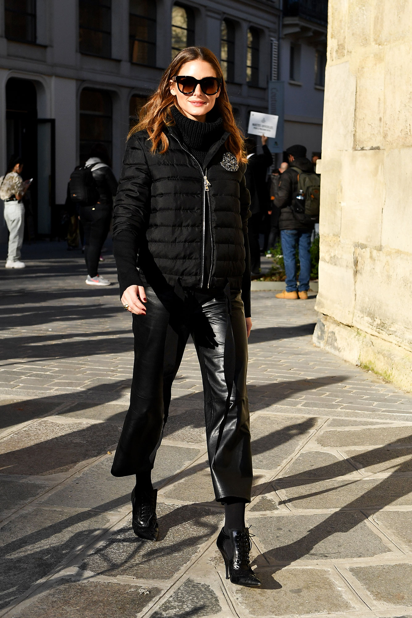 Olivia Palermo See the Stars' Street Style at Paris Fashion Week - Who says a puffer coat can't be cute? The socialite paired her black topper with leather pants and booties on her way to the Lanvin show on Wednesday, February 27.