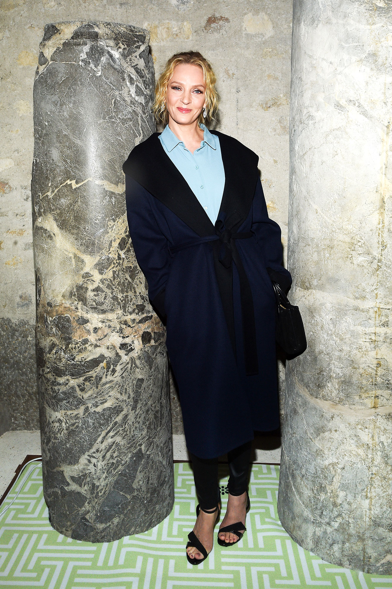 Uma Thurman See the Stars' Street Style at Paris Fashion Week - The Academy Award-winner offered a masterclass in transitional dressing at Lanvin on Wednesday, February 27, in her navy and black wrap-coat and strappy sandals.