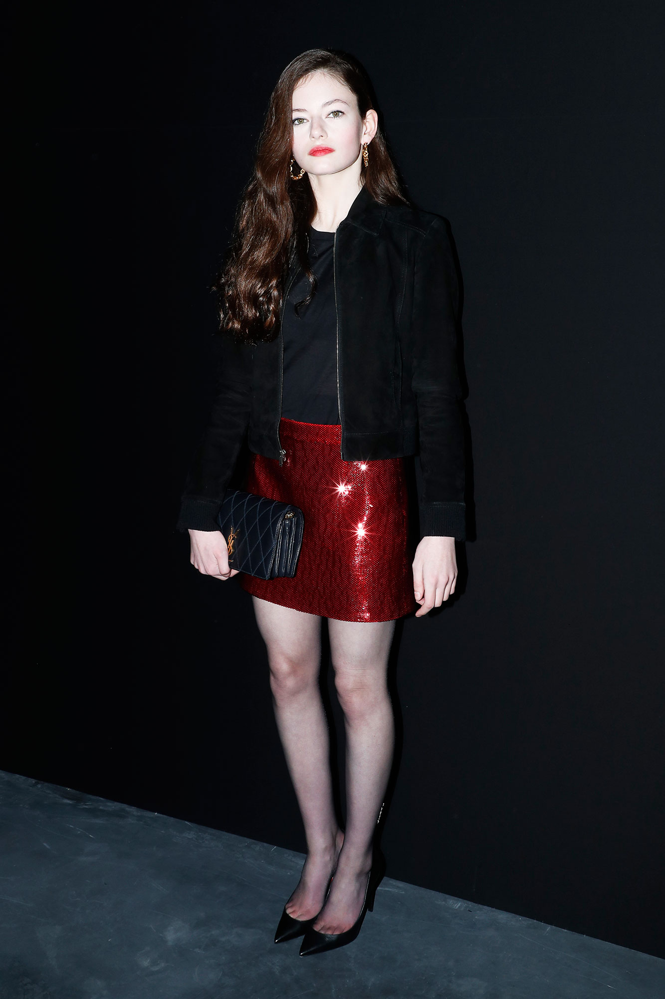 Mackenzie Foy See the Stars' Street Style at Paris Fashion Week - The actress made the case for matching your lipstick to your miniskirt at Saint Laurent on Tuesday, February 26.