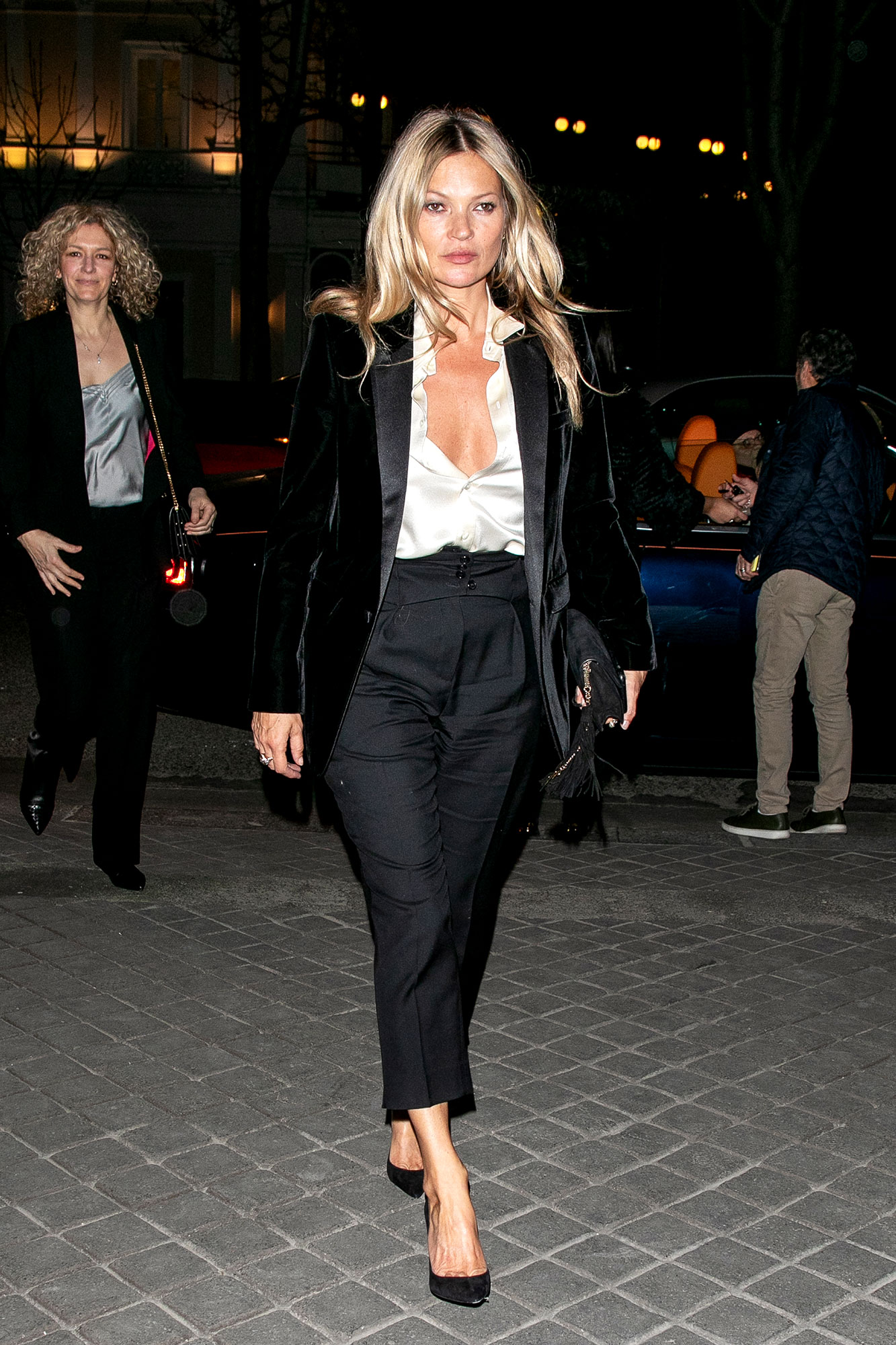 Kate Moss See the Stars' Street Style at Paris Fashion Week - The OG supermodel strutted her stuff in a super sexy pantsuit on her way to the Saint Laurent show on Tuesday, February 26.