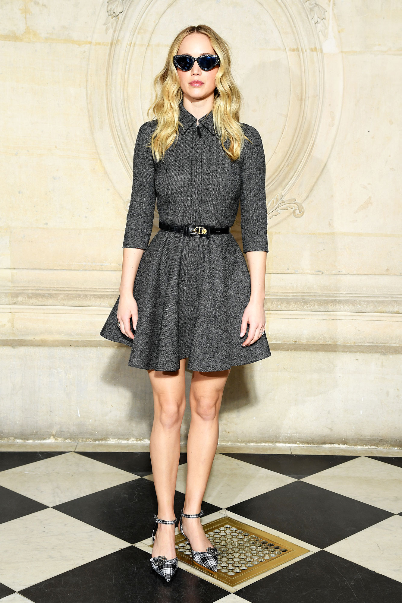 Jennifer Lawrence See the Stars' Street Style at Paris Fashion Week - The newly engaged actress kept things short and sweet in a fit-and-flare minidress and bedazzled shades at the Dior show on Tuesday, February 26.