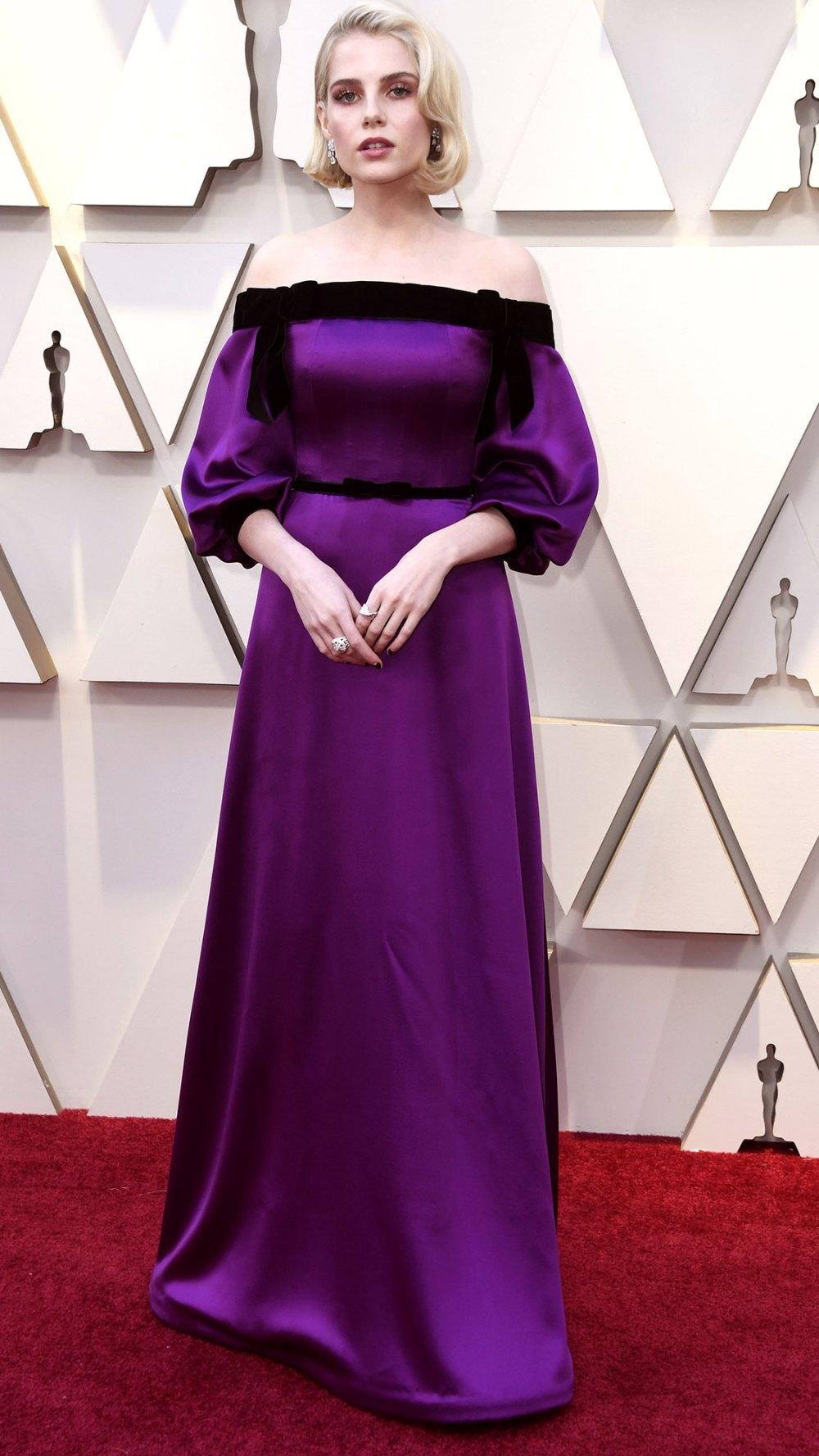 59515e61ba705 Hello Old Hollywood! Va-va-voom! Lucy looks like a frosty starlet in this  rich frock. I love the contrast of warm black velvet and cool purple satin.