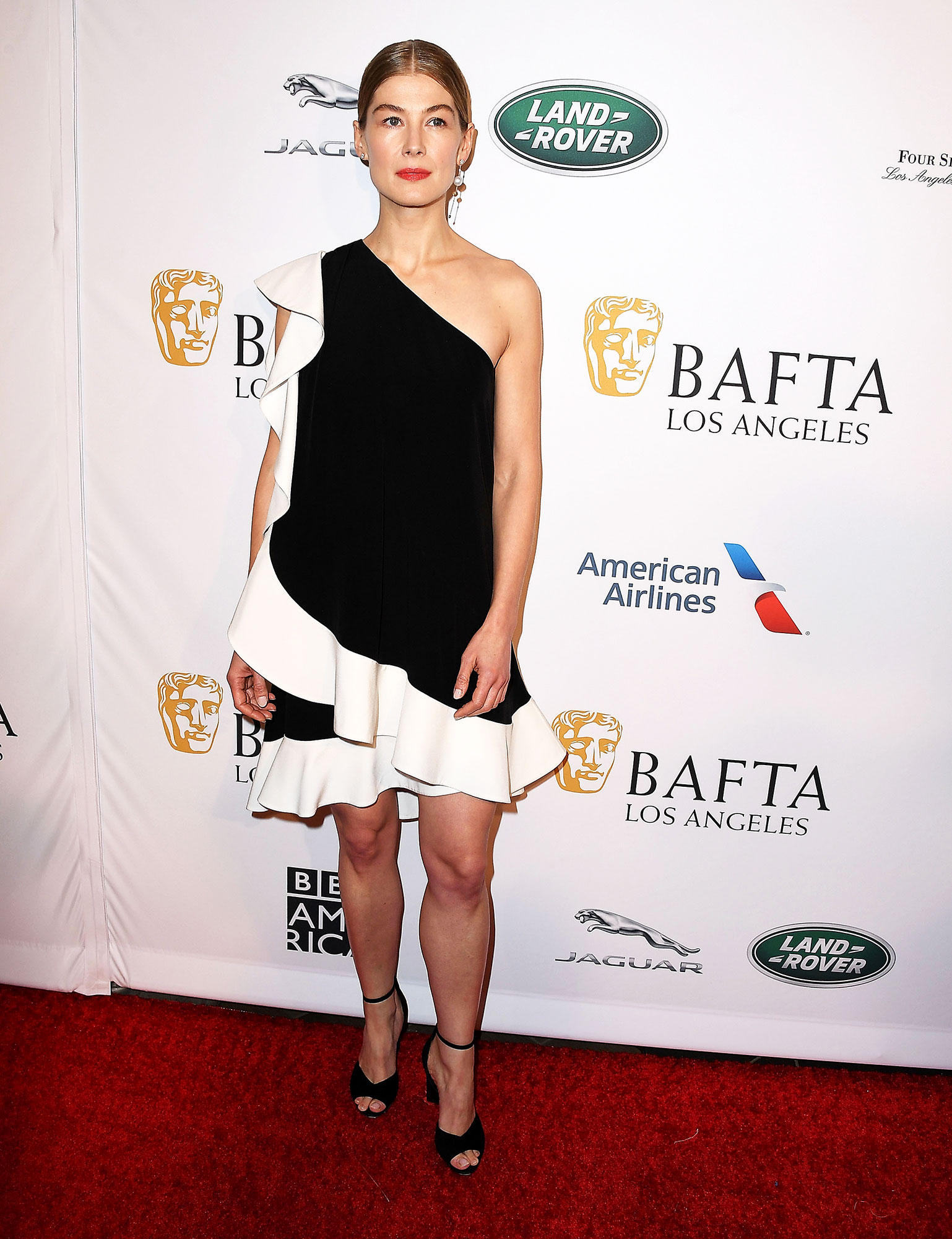 Rosamund Pike red carpet gallery for Stylish - black and white - In a $3,730 crepe Givenchy on Jan. 5.