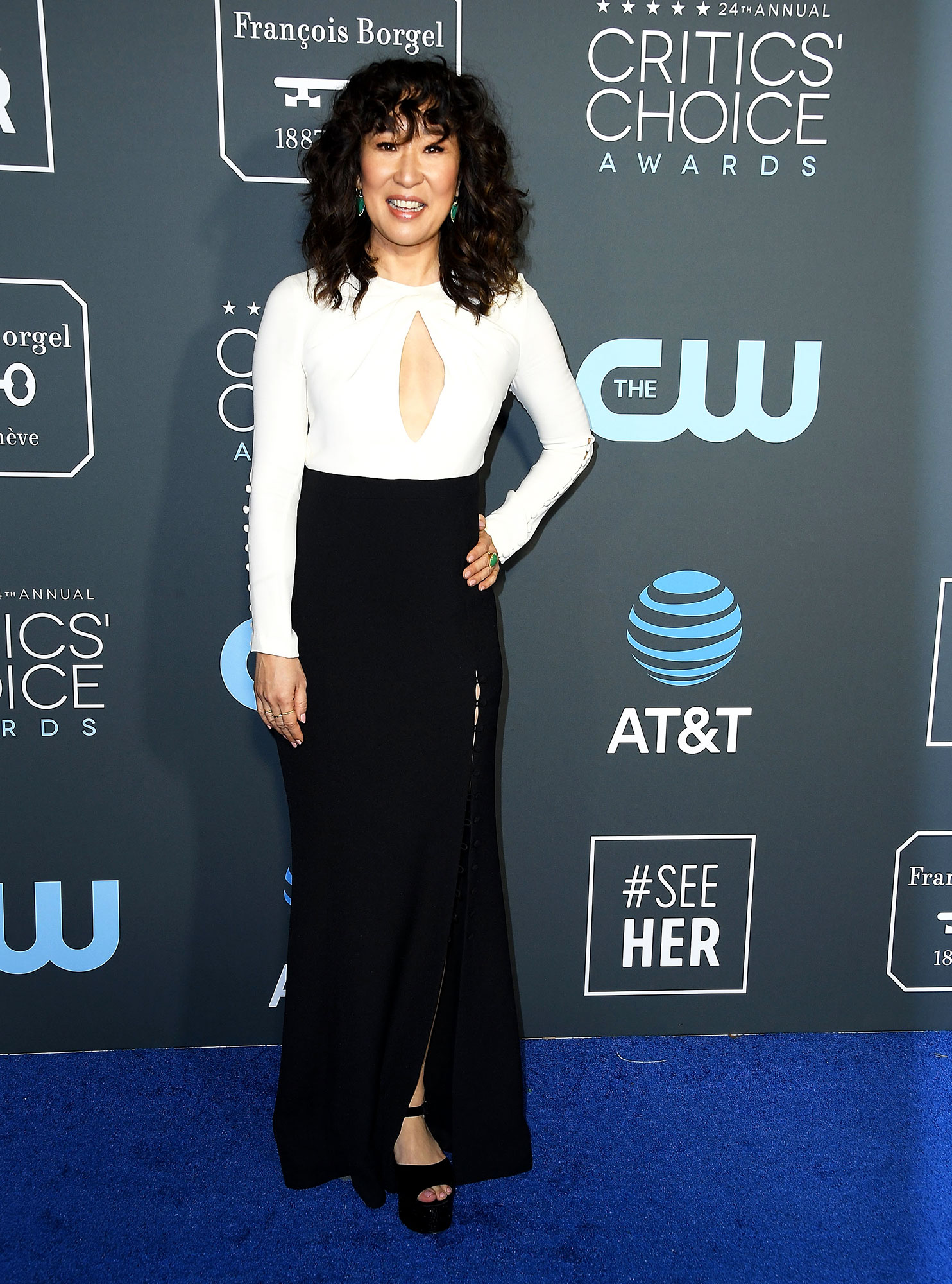 Sandra Oh red carpet gallery for Stylish - black and white - In a cutout Atelier Prabal Gurung on Jan. 13.