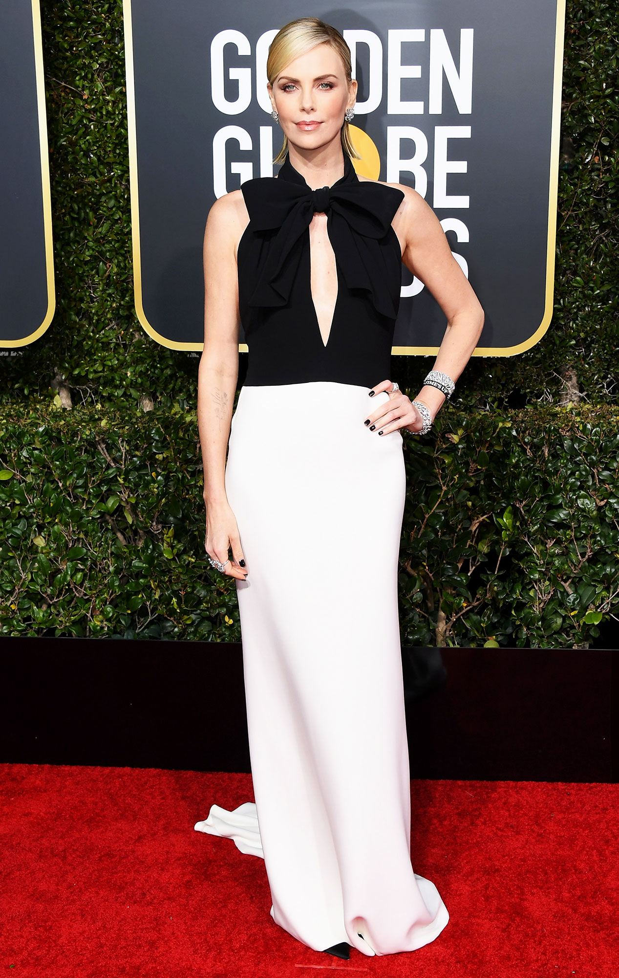 Charlize Theron red carpet gallery for Stylish - black and white - In a silk Dior Haute Couture on Jan. 6.