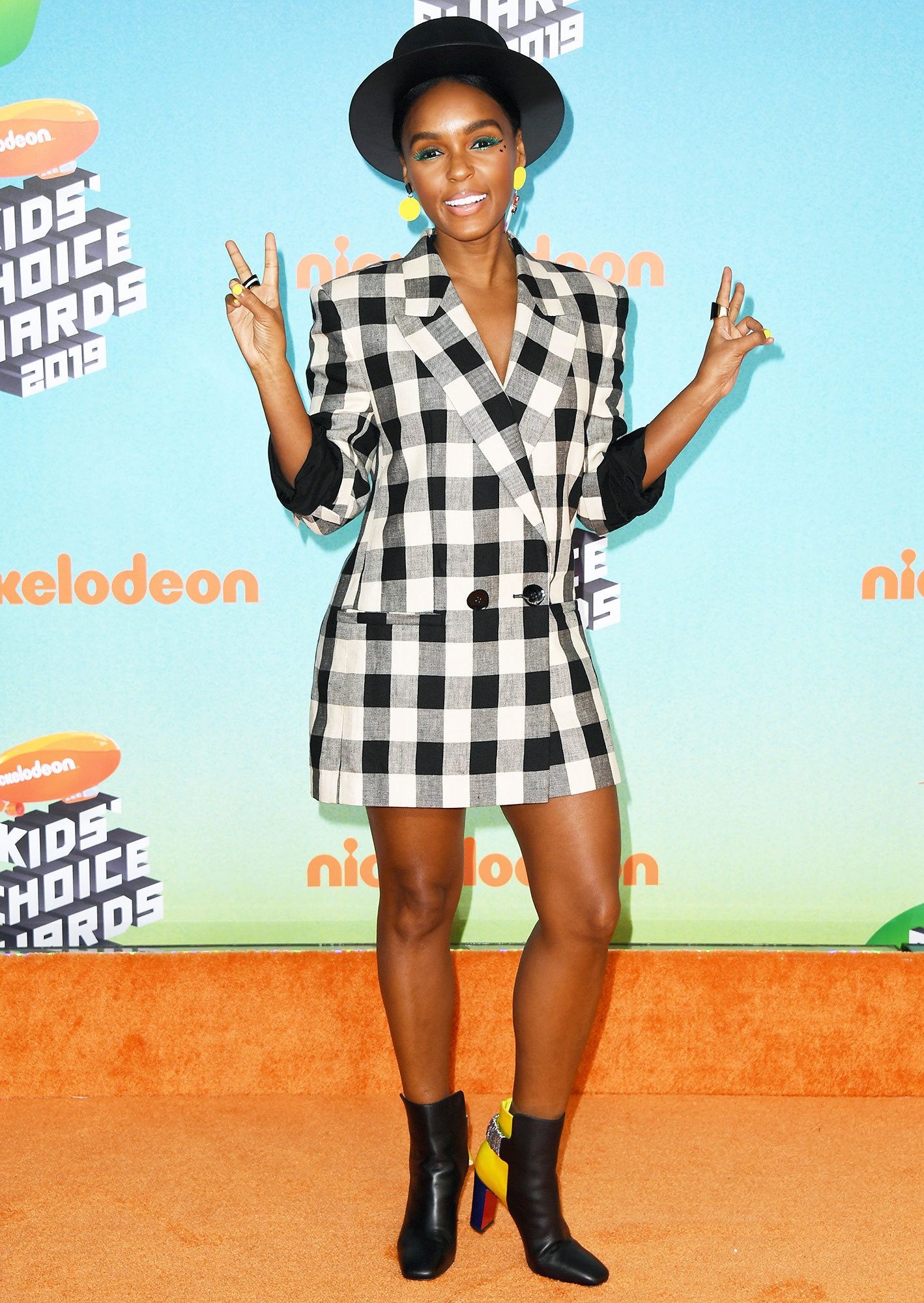 """Nickelodeon Kids Choice Awards 2019 Janelle Monae - Embracing the pantsless trend, the """"Make Me Feel"""" singer wore a black and white checkered blazer from Petar Petrov blazer which she accessorized with cool Christian Louboutin booties and a YVY hat."""