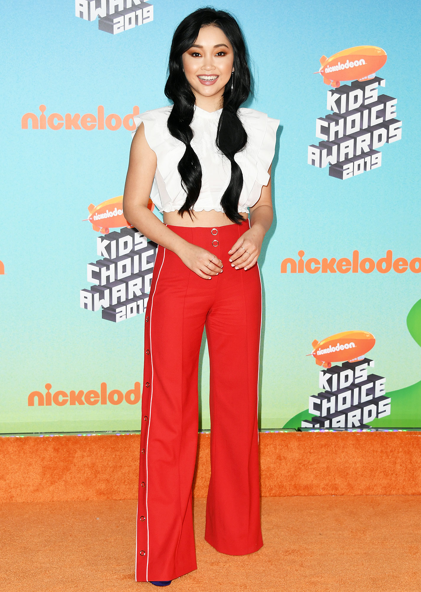 Nickelodeon Kids Choice Awards 2019 Lana Condor - Making an argument for red carpet track pants, the To All the Boys I Loved star wore red Jonathan Simkhai snap wool trousers with a cropped Giamba blouse