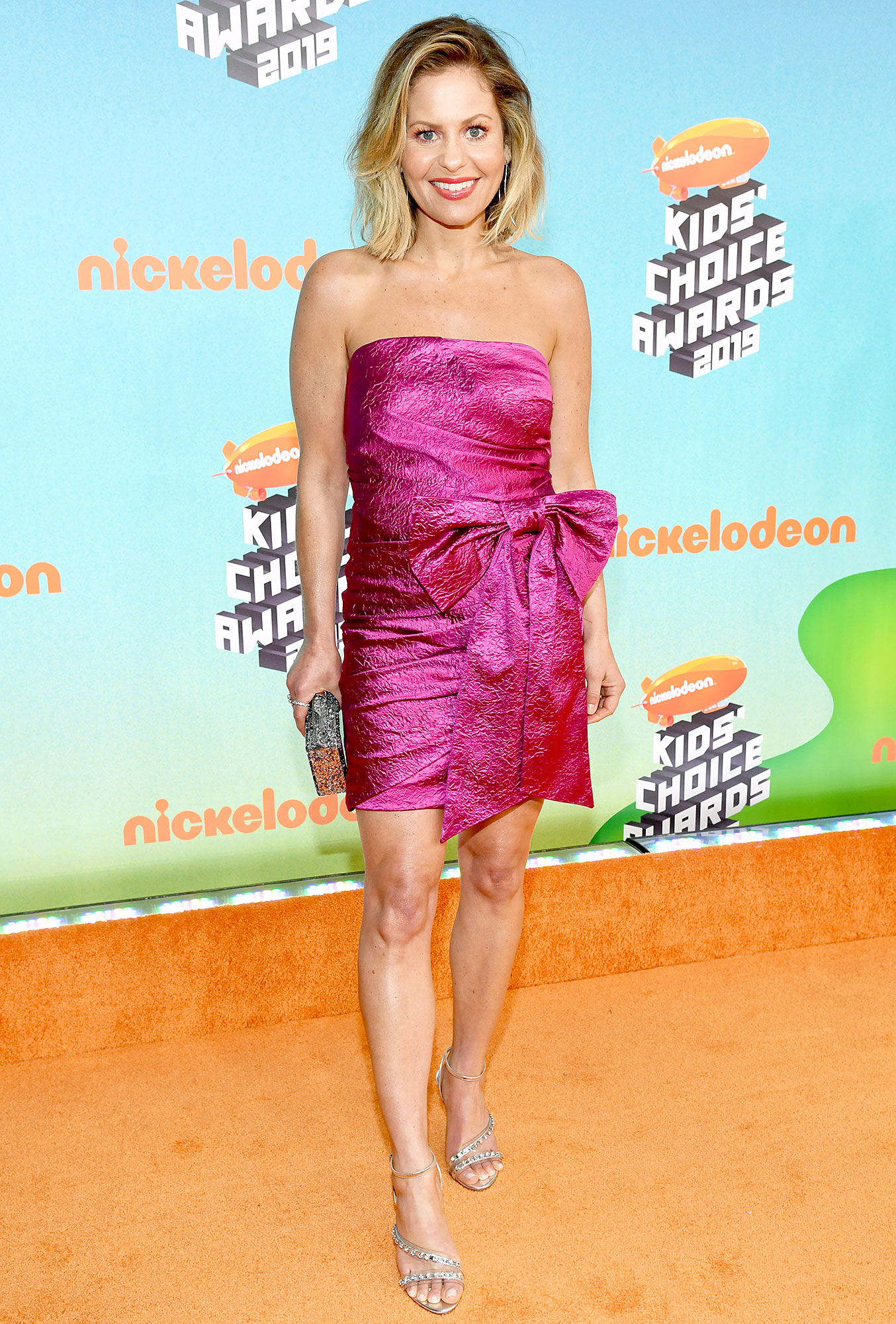 Nickelodeon Kids Choice Awards 2019 Candace Cameron Bure - The Full House actress dazzled in a hot pink cocktail dress with an oversized bow at the waist and strappy silver stilettos.