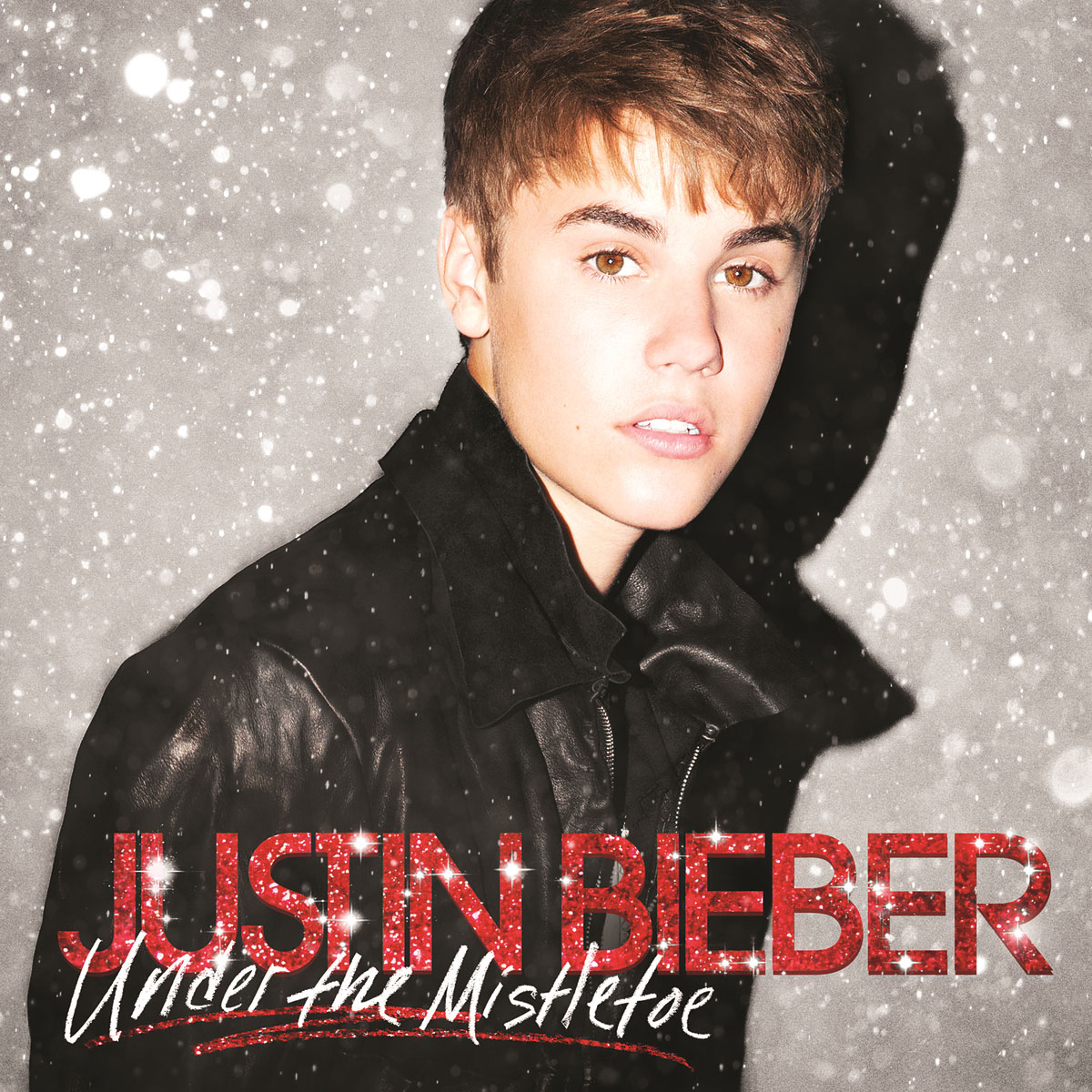 """Justin Bieber Through The Years Under The Mistletoe - Hot off the success of Never Say Never , Bieber released his Christmas album, Under the Mistletoe . In addition to lead single """"Mistletoe,"""" he teamed up with Mariah Carey for a """"superfestive"""" rendition of her 1994 classic """"All I Want for Christmas Is You."""""""