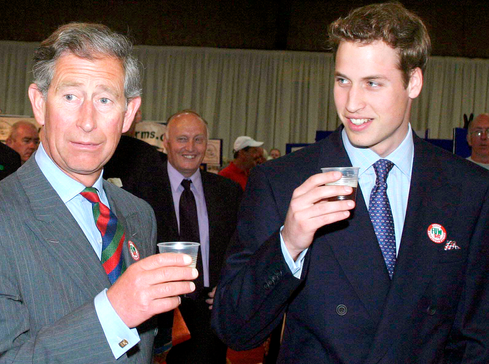 A-Beer-for-the-Birthday-Boy-Prince-Charles-And-Prince-William-beer - In June 2003, Prince William, who was days shy of celebrating his 21st birthday, had a beer on a visit to the Anglesey Agricultural centre in Anglesey, Wales, with his father, Prince Charles. The outing was part of the royal's birthday tour of Wales.