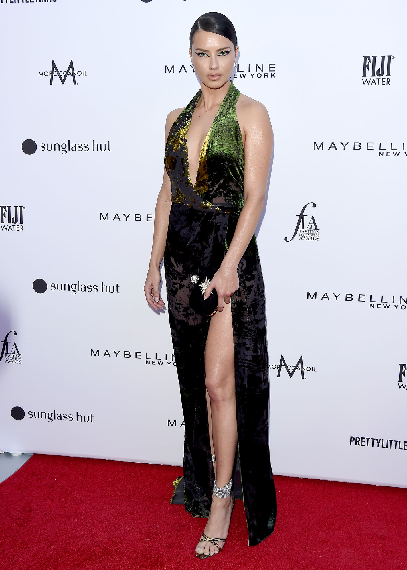Stars Brought Their Style A-Game to the Daily Front Row Fashion Awards - Flaunting her toned limbs, the former Victoria Secret model wore a reptilian print dress with a thigh-high slit and plunging neckline.
