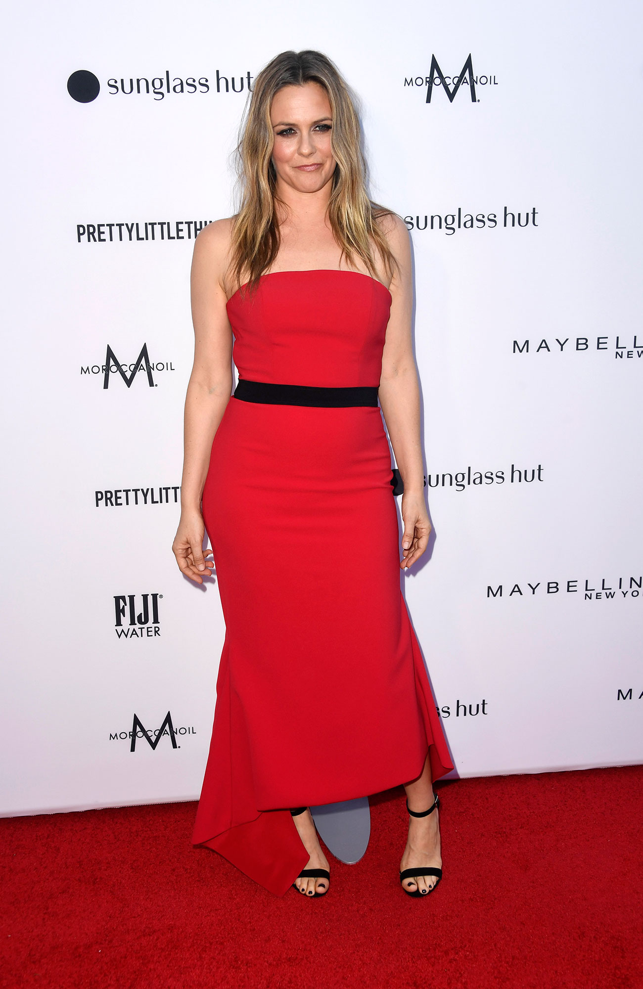 Stars Brought Their Style A-Game to the Daily Front Row Fashion Awards - The Clueless star looked ageless in a strapless red dress with a black bow around the waist the matched her simple sandal heels.