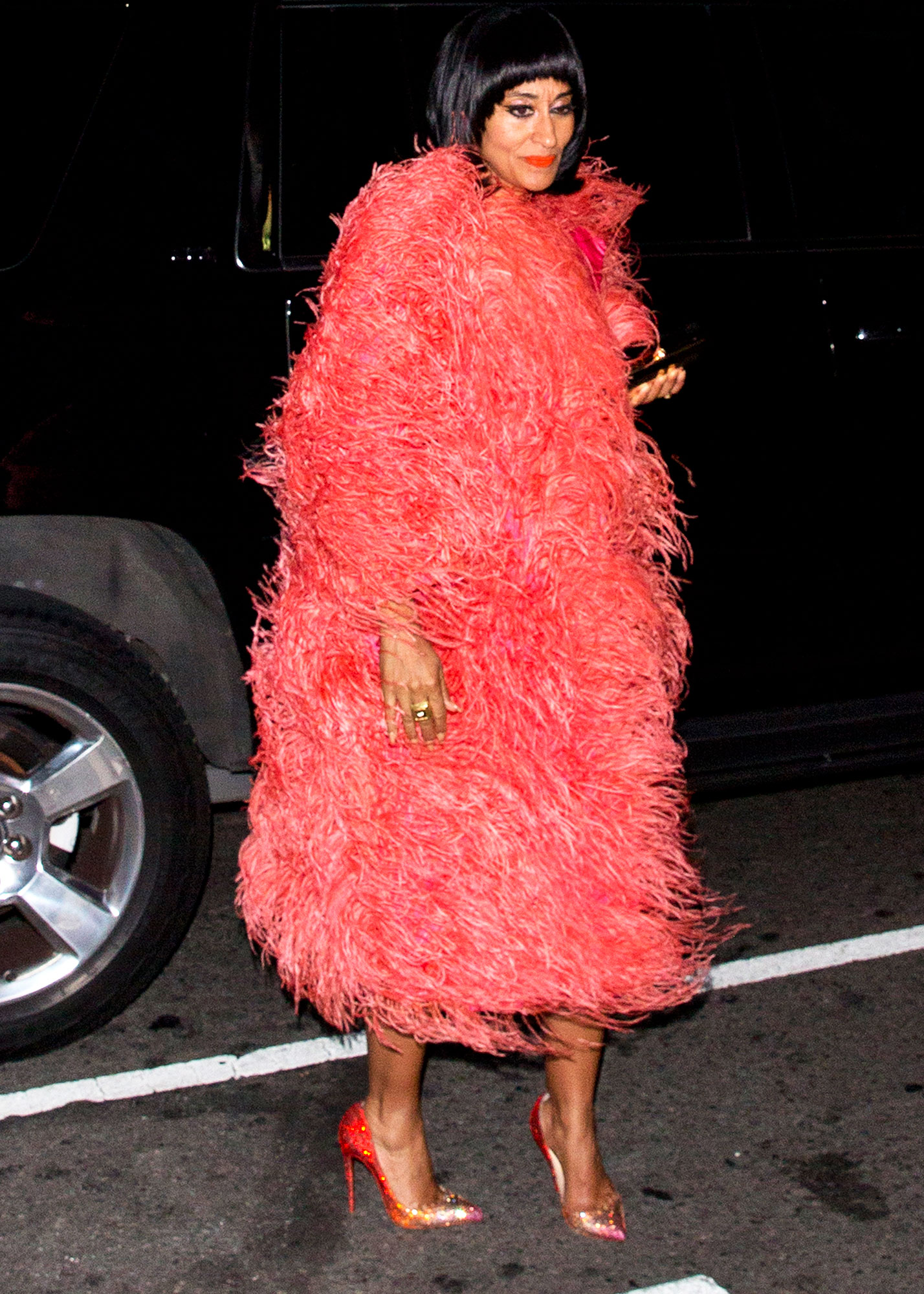 Tracee Ellis-Ross All the Disco Star Style From Diana Ross' 75th Birthday Party - The Black-ish star paid homage to her mom's iconic style in a feathery Marc Jacobs coat, Versace dress and Christian Louboutin pumps.