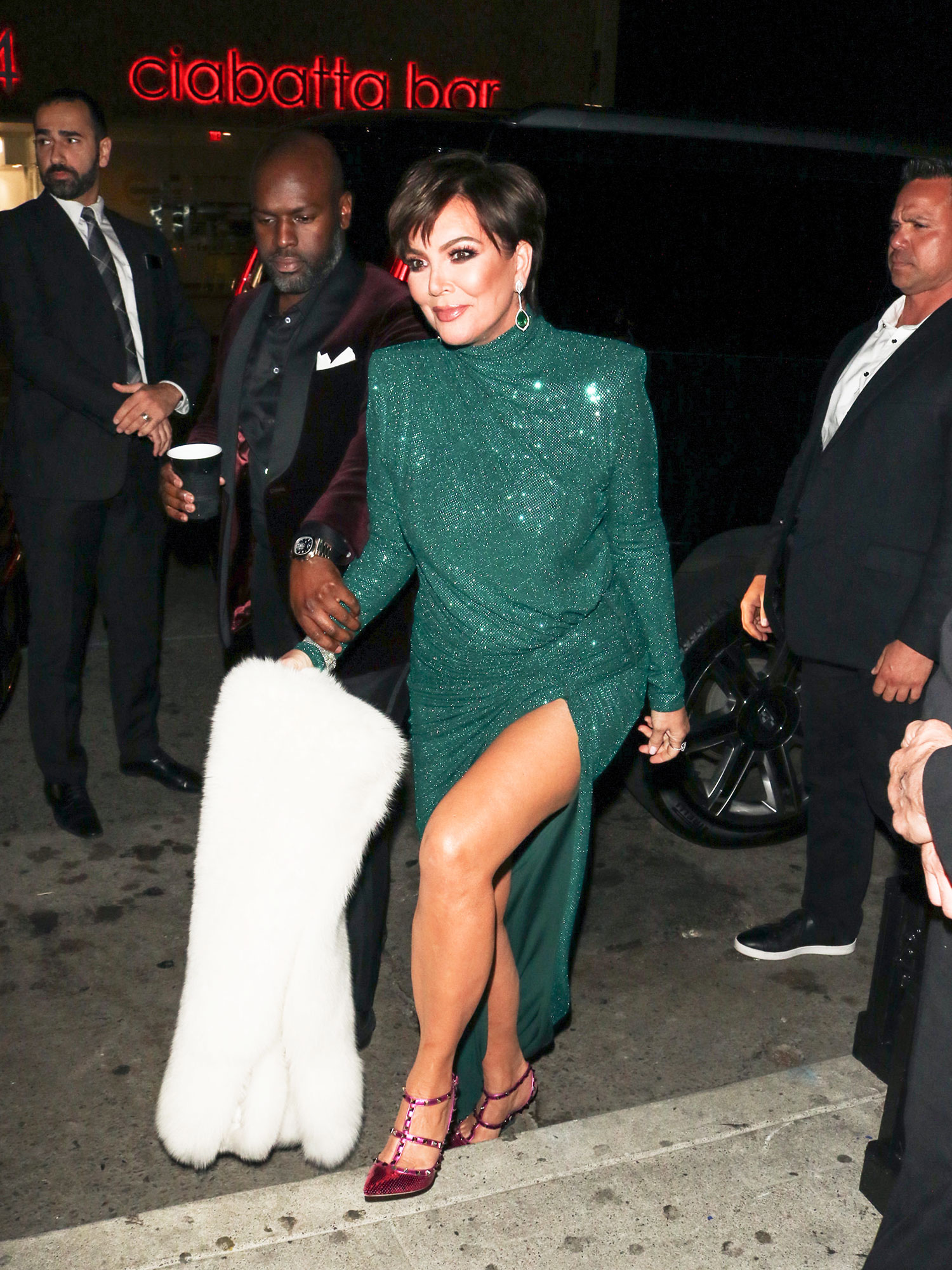 Kris Jenner All the Disco Star Style From Diana Ross' 75th Birthday Party - We were green with envy over the Keeping Up With the Kardashians star's shimmering emerald frock and hot pink Valentino pumps.