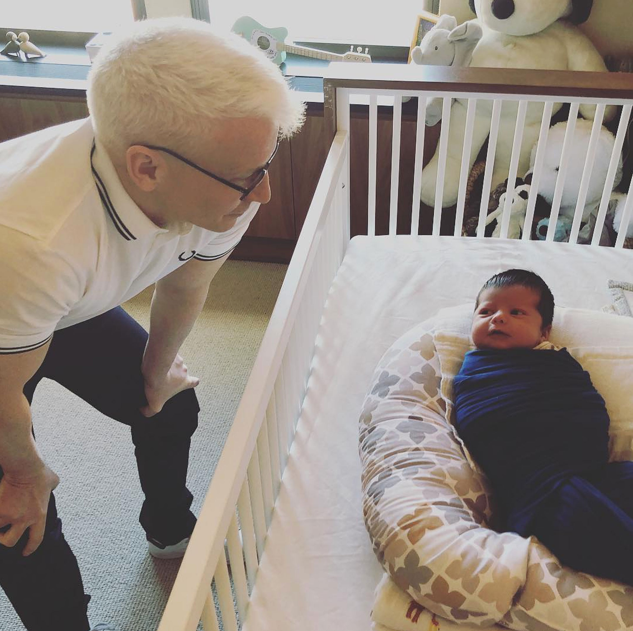 Andy Cohen Introduces Baby Benjamin To Anderson Cooper - The journalist and Cohen have remained good friends after meeting on a failed blind date and have cohosted CNN's New Year's Eve coverage since 2018.