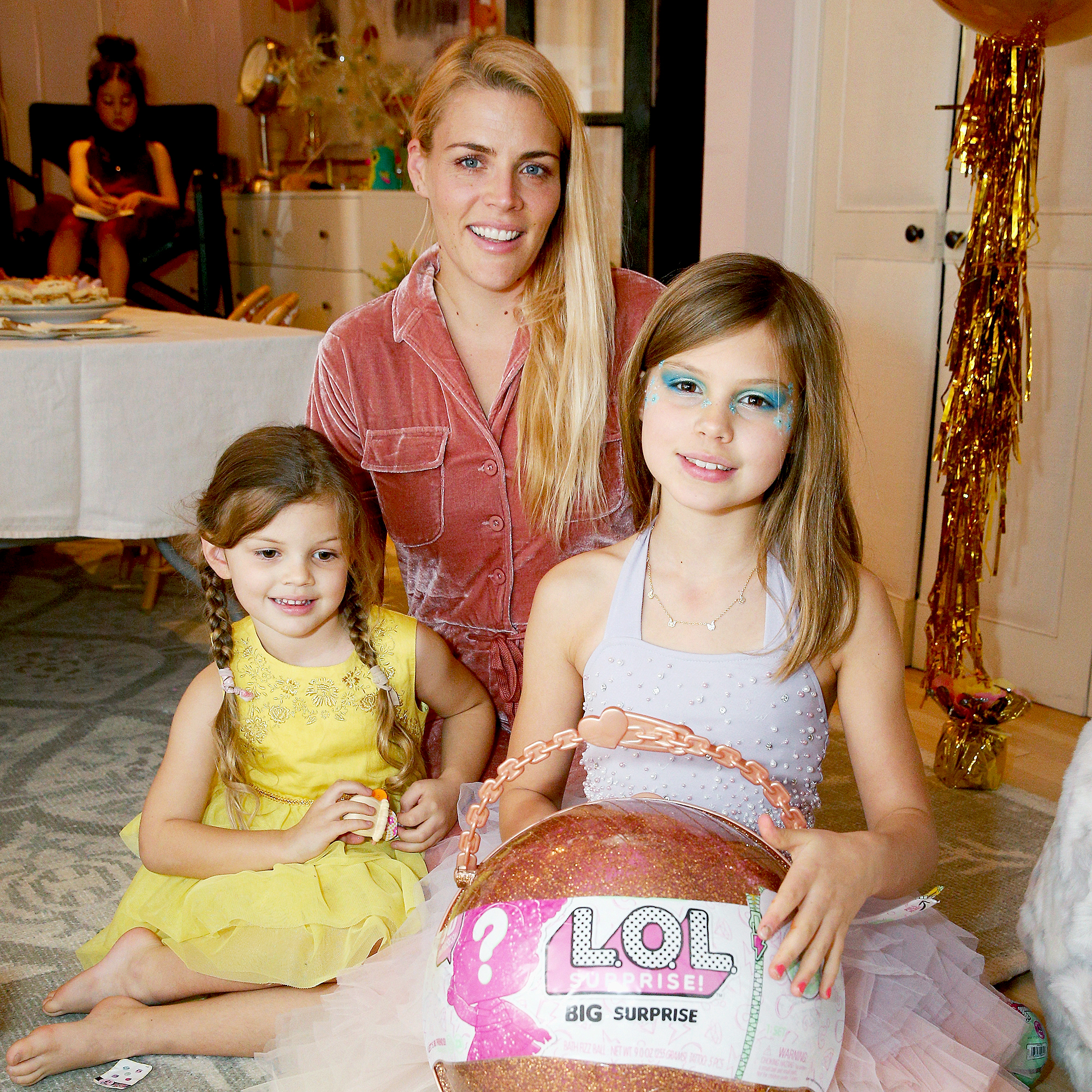 Birdie-Leigh-and-Cricket-Pearl-Silverstein-Busy-Philipps-kids-named-after-animals - LOS ANGELES, CA – DECEMBER 14: (L-R) Cricket Pearl Silverstein, Busy Philipps, and Birdie Leigh Silverstein attend L.O.L. Surprise! NYE Party Hosted by Busy Phillips & Sara Foster with daughters on December 14, 2017 in Los Angeles, California.