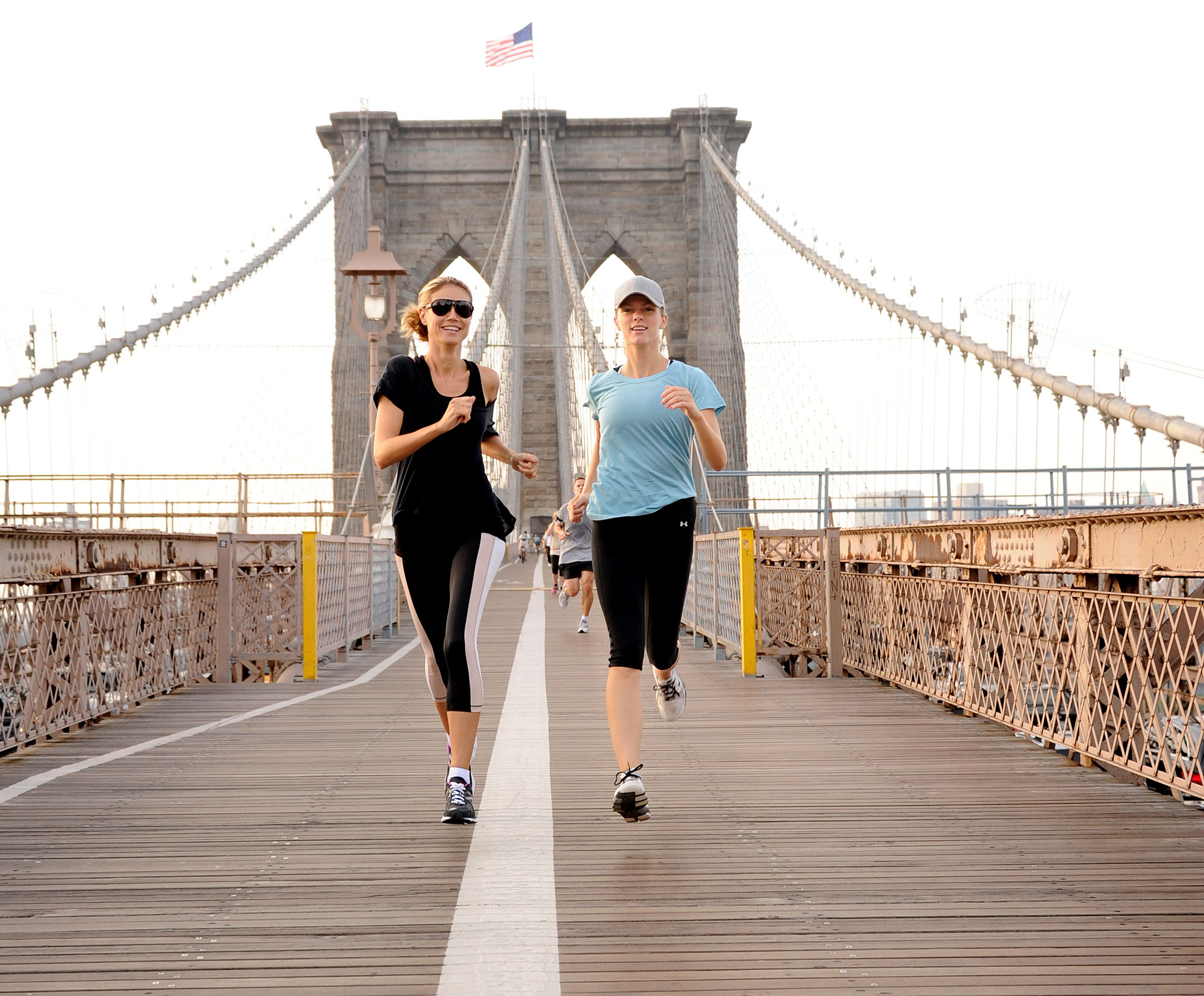 Brooklyn Decker Heidi Klum Celebrity Joggers - NEW YORK, NY – JULY 12: (EXCLUSIVE COVERAGE) Brooklyn Decker joins Heidi Klum on her AOL summer run across the Brooklyn Bridge on July 12, 2011 in New York City. (Photo by Kevin Mazur/WireImage)