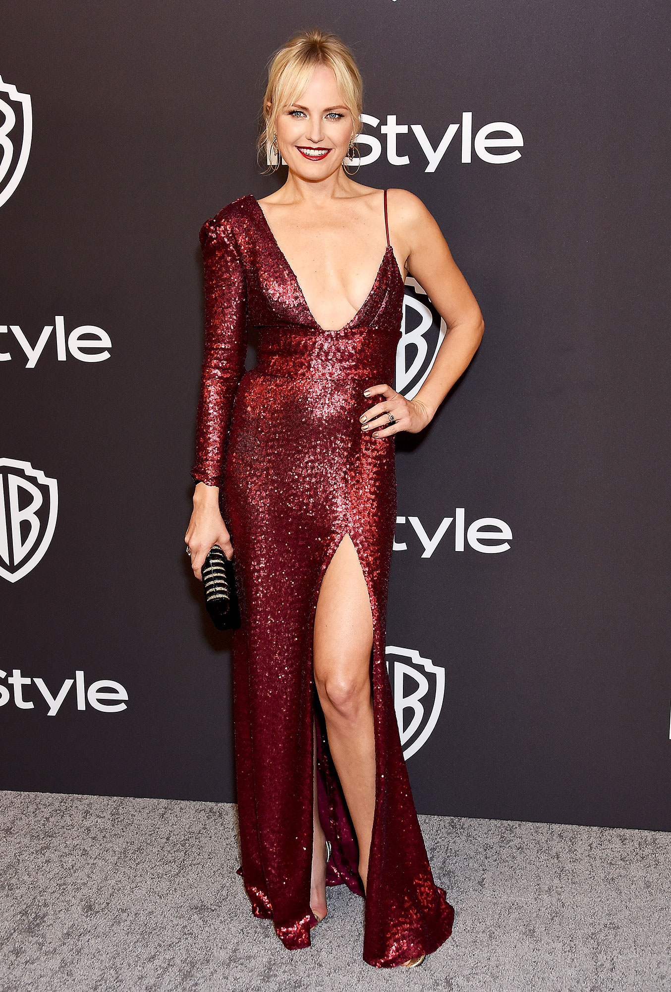 Stylish Burgundy Malin Akerman - In a high-slit Iris Serban on Jan. 6.