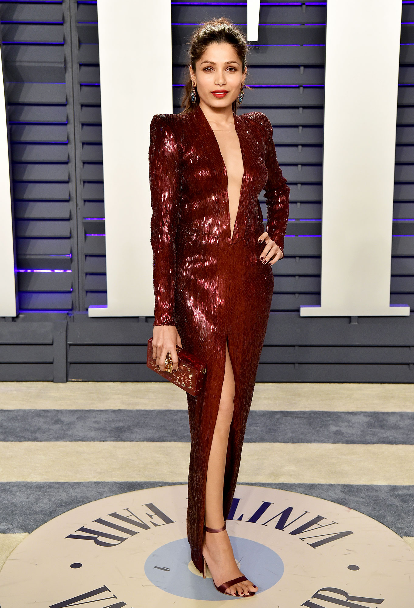 Stylish Burgundy Freida Pinto - In a low-cut Julien Macdonald on Feb. 24.