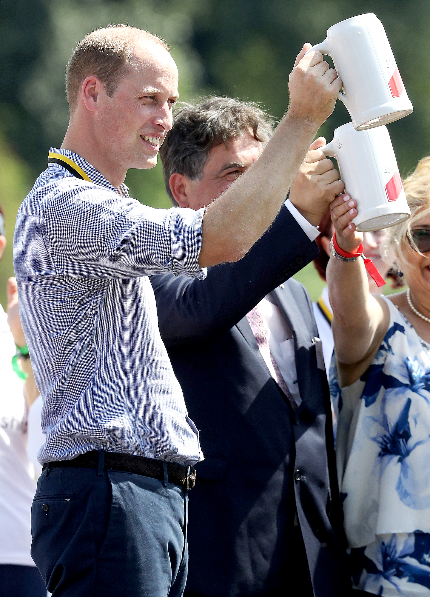 Celebrating-a-Job-Well-Done-prince-william-beer - The Duke of Cambridge toasted with a beer in Heidelberg, Germany, after participating in a rowing race between the twinned town of Cambridge and Heidelberg and against Catherine, Duchess of Cambridge on the second day of the couple's official visit to Germany on July 20, 2017.