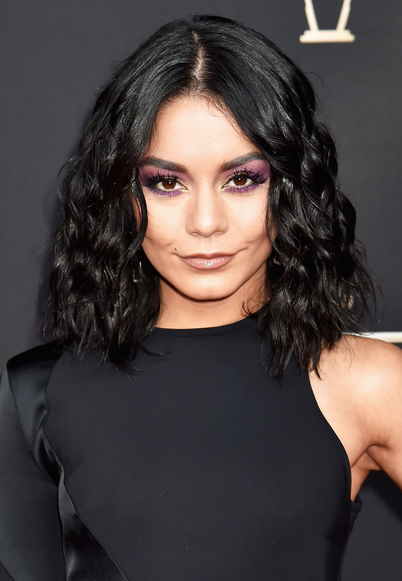 Vanessa Hudgens Celebs Are Here With All the Coachella Beauty Inspo You Need - Purple rain! Rather than keep the color merely on the lid makeup artist Allan Avendaño used a metallic golden shade on the Rent Live star's lids at the 2019 NFL Honors awards before smoking out a shimmering plum hue up to the brow bone and down around the lower lash line.