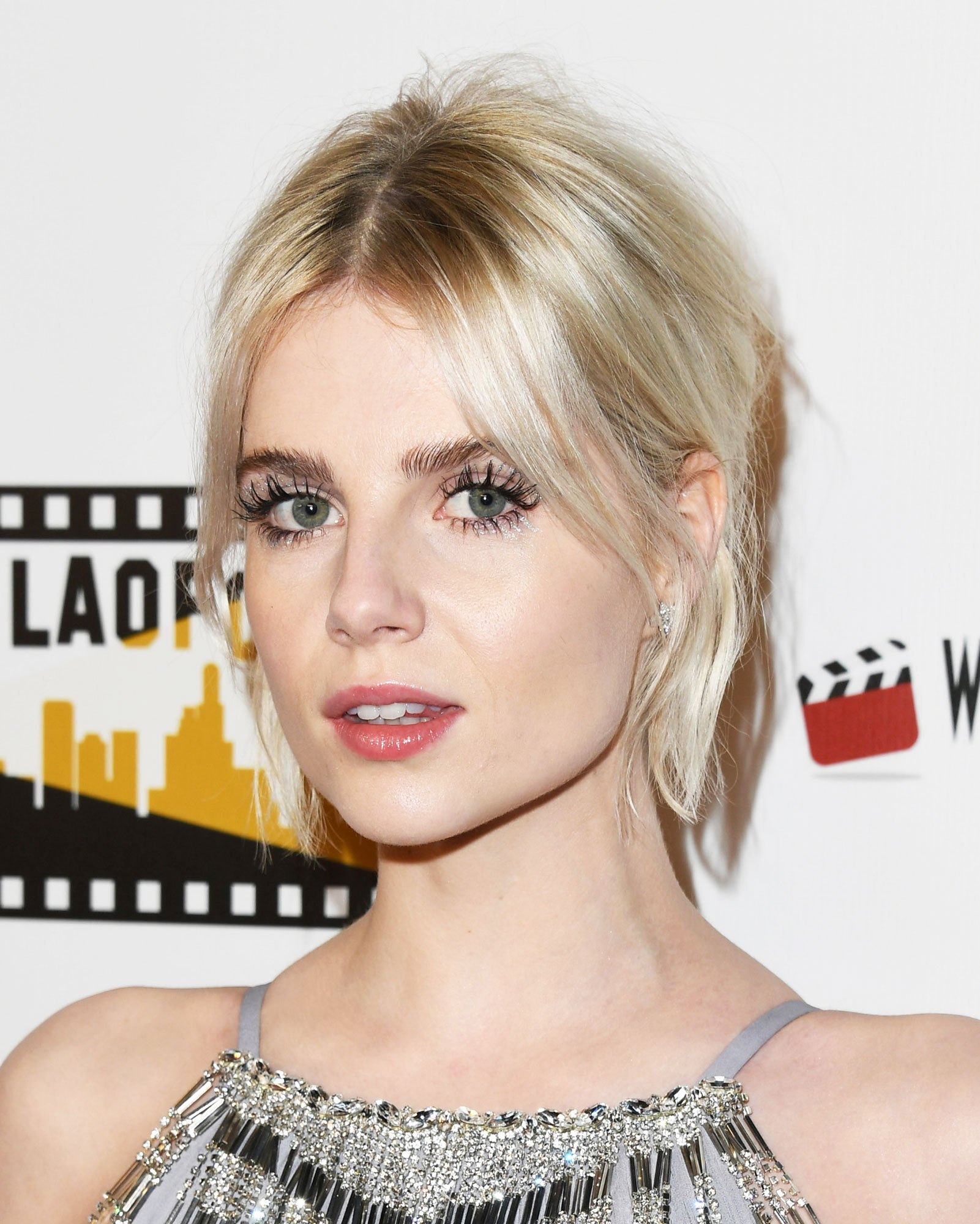 Lucy Boynton Celebs Are Here With All the Coachella Beauty Inspo You Need - David Bowie's Ziggy Stardust was the inspiration behind the Bohemian Rhapsody actress' sparkly lash look at the Los Angeles Online Film Critics Society Awards. Makeup artist Jo Baker used a combo of metallic shadows and Lemonhead.