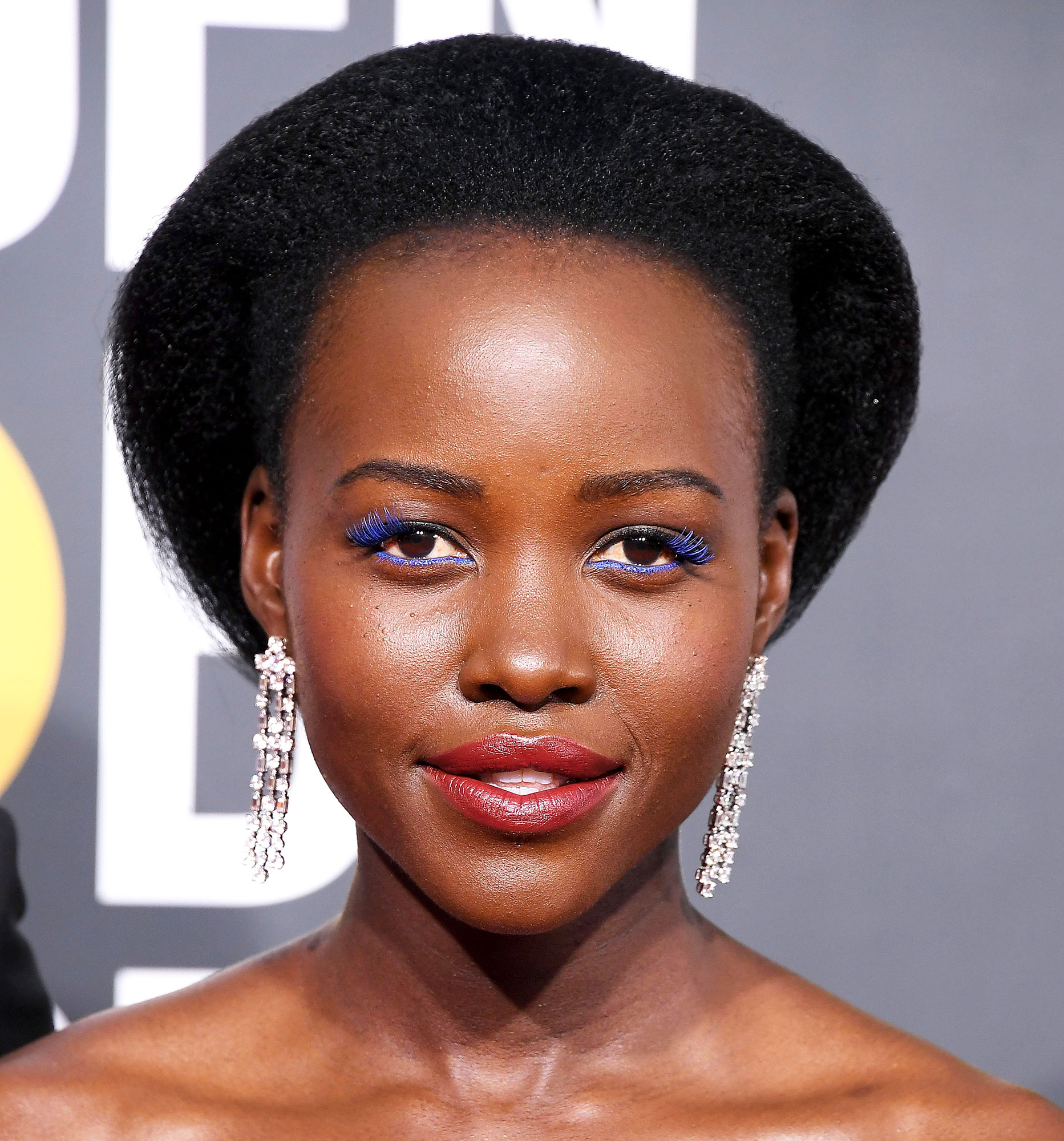 """Lupita Nyong'o Celebs Are Here With All the Coachella Beauty Inspo You Need - A combination of the Lancome Drama Liqui-Pencil eyeliner in Cote d'Azur and Lashify Prismatic Gossamer falsies in Royal Blue on outer corners proved to be the perfect pair for the Us star at the 2019 Golden Globes. Her go-to makeup artist Nick Barose called the look """"a lil bit '80s fun,"""" and we couldn't agree more."""