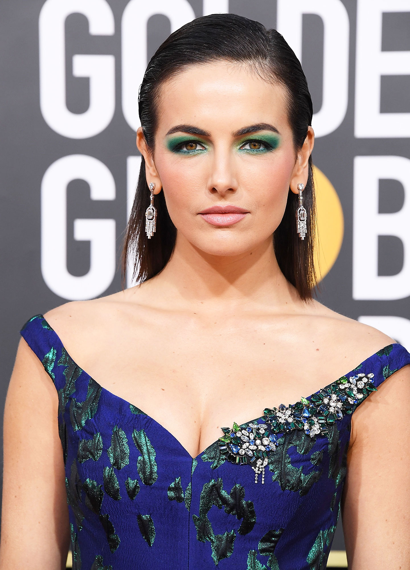 Camilla Belle Celebs Are Here With All the Coachella Beauty Inspo You Need - We're calling it: mermaid makeup is the new unicorn makeup, and artist Hung Vanngo created the actress' aquatic look at the Golden Globes with Chanel beauty. He used the teal and green shades in brand's Les 4 Ombres Multi-Effect Quadra Eyeshadow in 306 Splendeur et Audace all over the lid and added definition with the Stylo Yeux Waterproof Long-Lasting Eyeliner in 938 Mare-Chiaro (a shimmering mint) and 88 Noir Intense (a jet black).