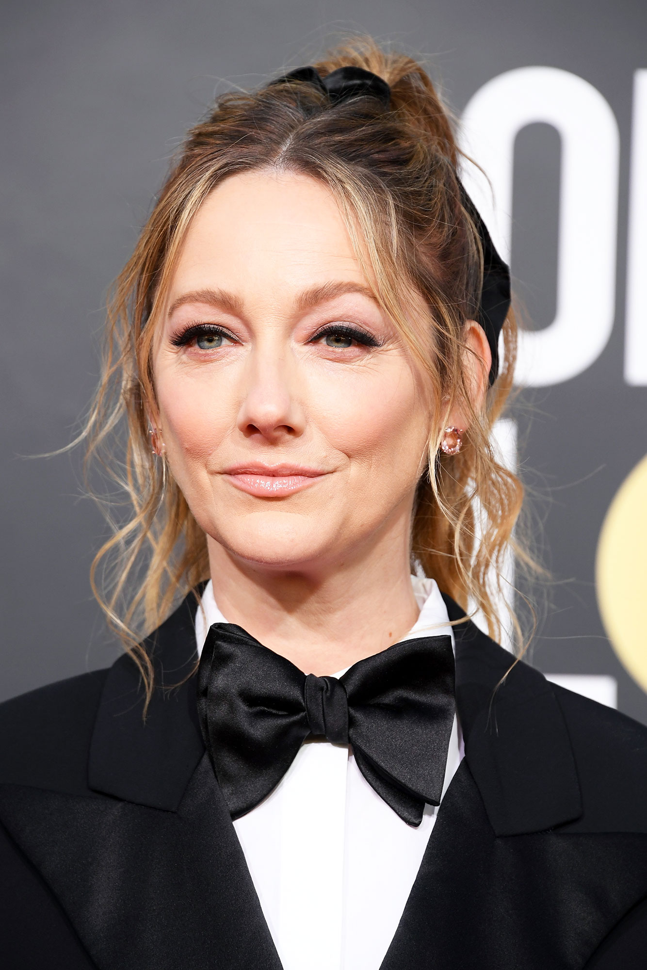 Judy Greer Celebs Are Here With All the Coachella Beauty Inspo You Need - A center part, tousled waves and wispy fly-aways makes the actress' 2019 Golden Globes pony (by mane man Gregory Russell) perfect for keeping cool — literally and figuratively — in the desert.